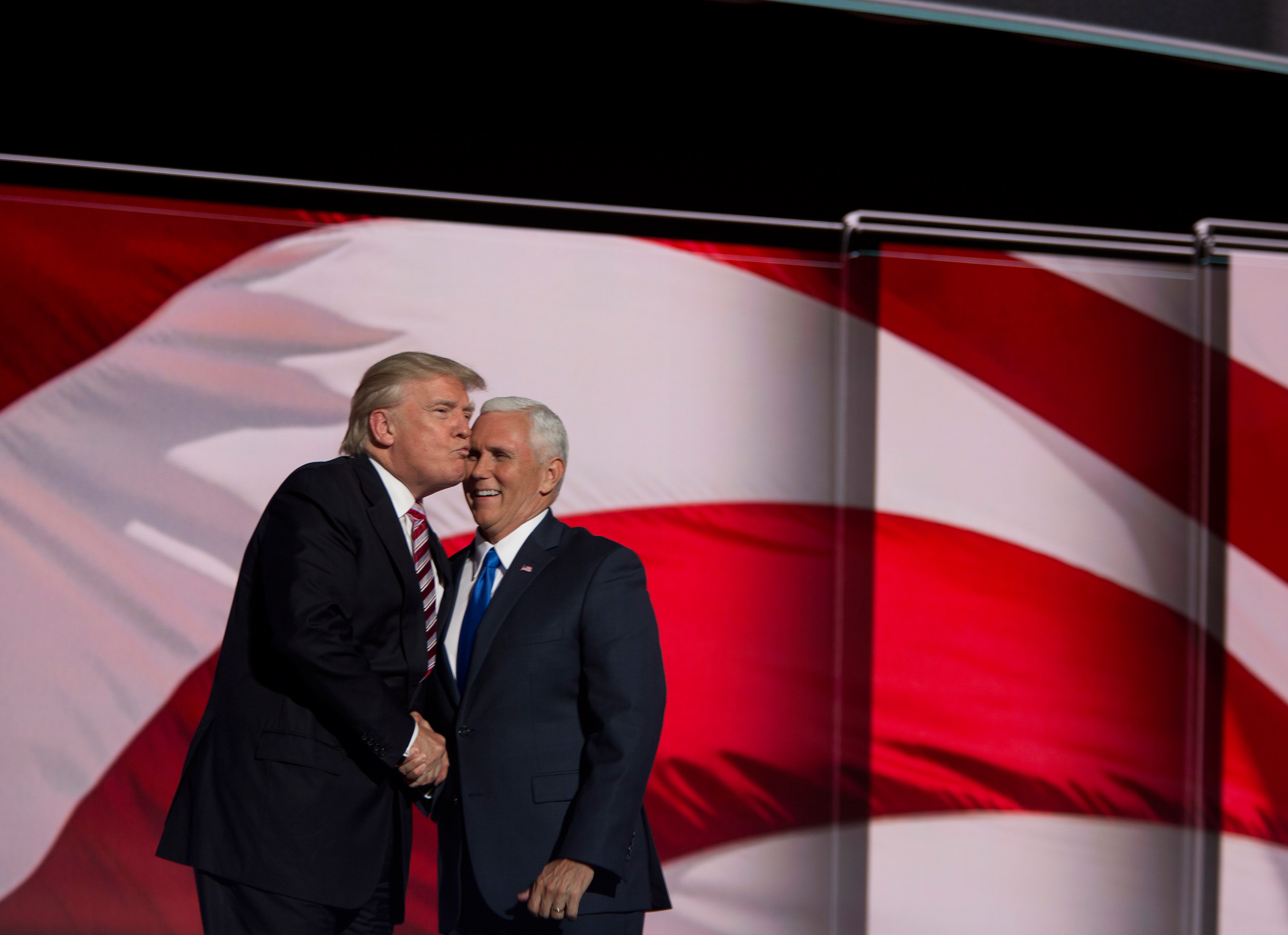 Republican presidential candidate Donald Trump congratulates Republican vice presidential candidate Mike Pence after he delivered a speech on the third day of the Republican National Convention on July 20, 2016 at the Quicken Loans Arena in Cleveland, Ohio.From  The 82 Most Unforgettable Photos From the Election