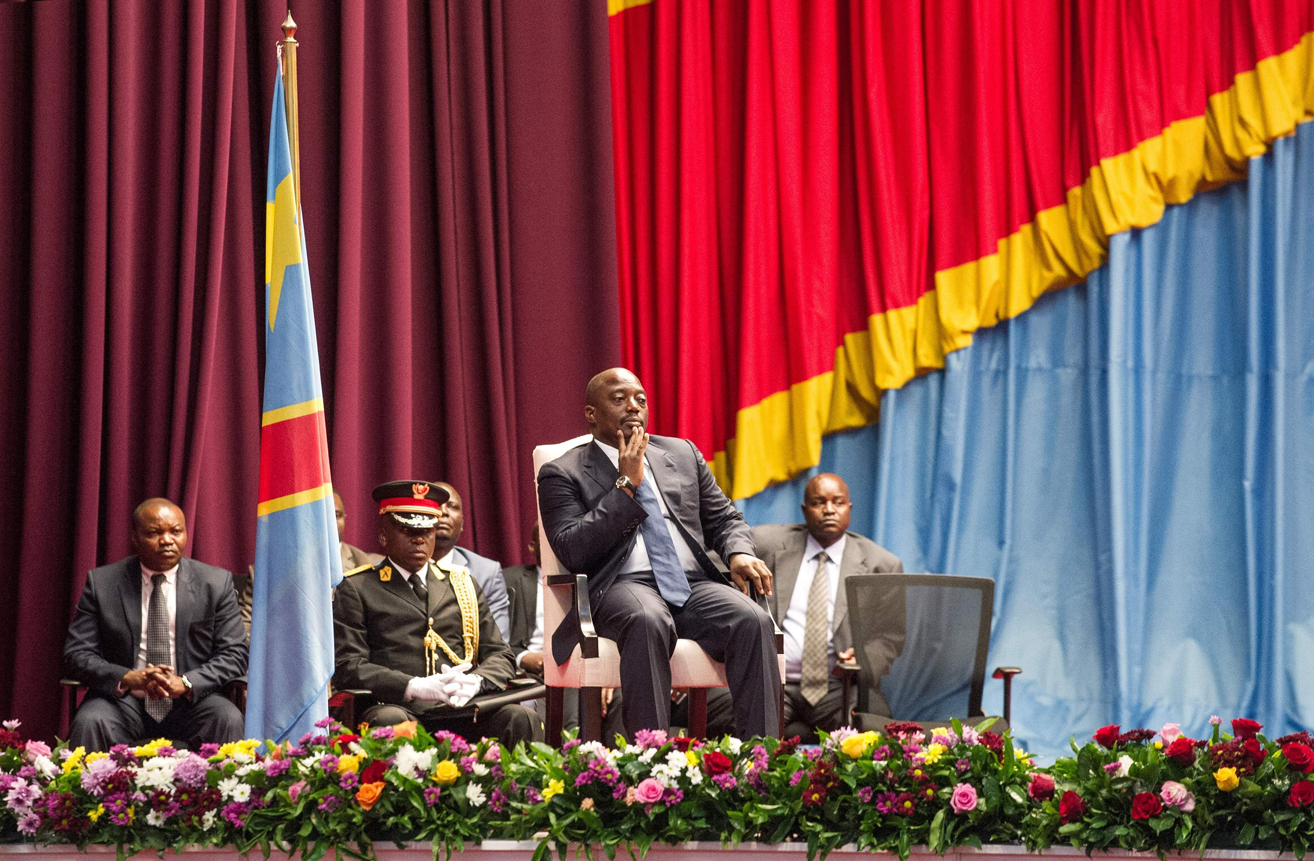 Congolese President Joseph Kabila sits during a special joint session of parliament in Kinshasa on Nov. 15, 2016, the day after Prime Minister Augustin Matata resigned to make way for an opposition figure in line with a controversial deal that effectively extended the president's term in office.