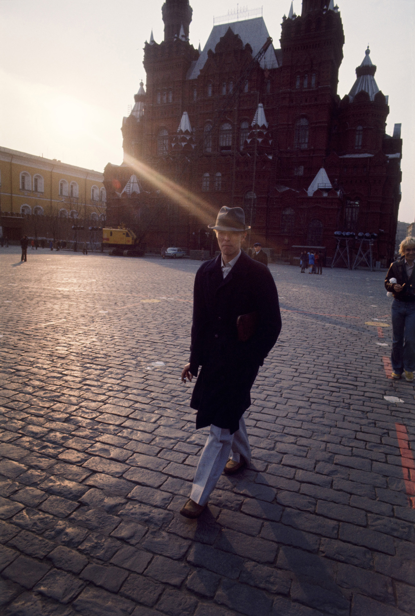 Bowie takes a walk around Moscow's Red Square at sunset.
