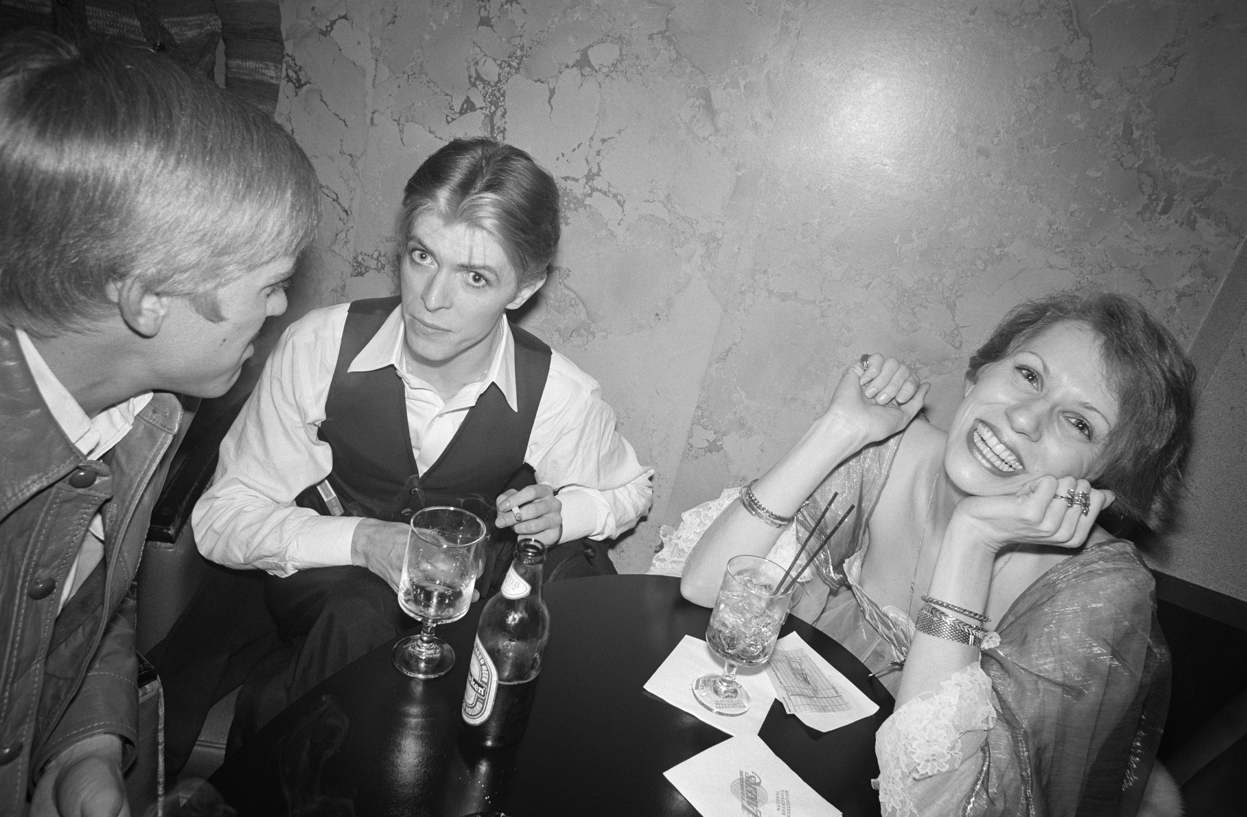 """Bowie and his wife, Angela, with President Gerald Ford's son, Steven, at a party in Los Angeles celebrating """"Fame"""" being certified a gold record, 1975."""