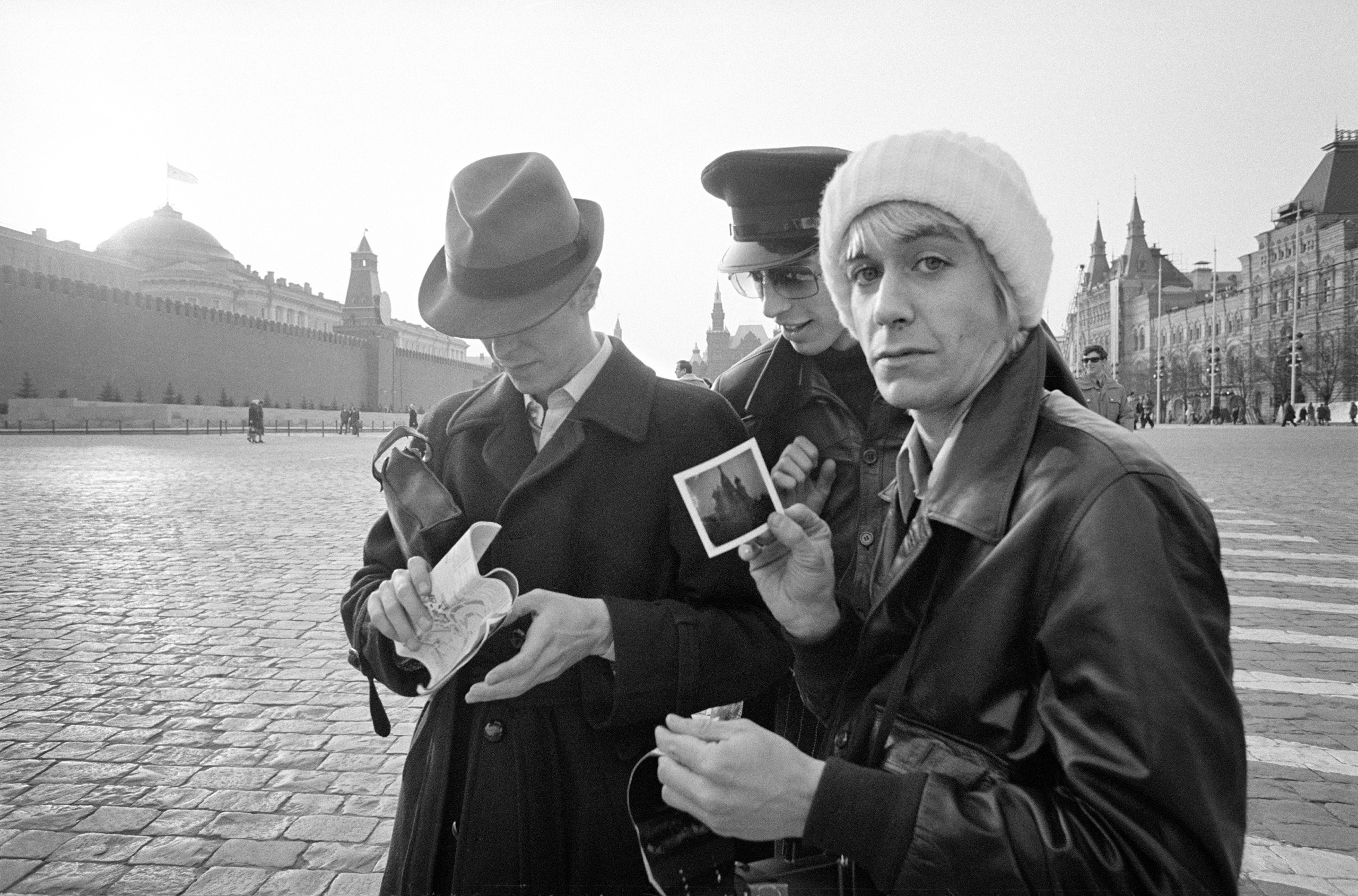 Iggy Pop flashes a Polaroid he'd just taken in Moscow's Red Square. Bowie and his tour manager, Pat Gibbons, are in the background.