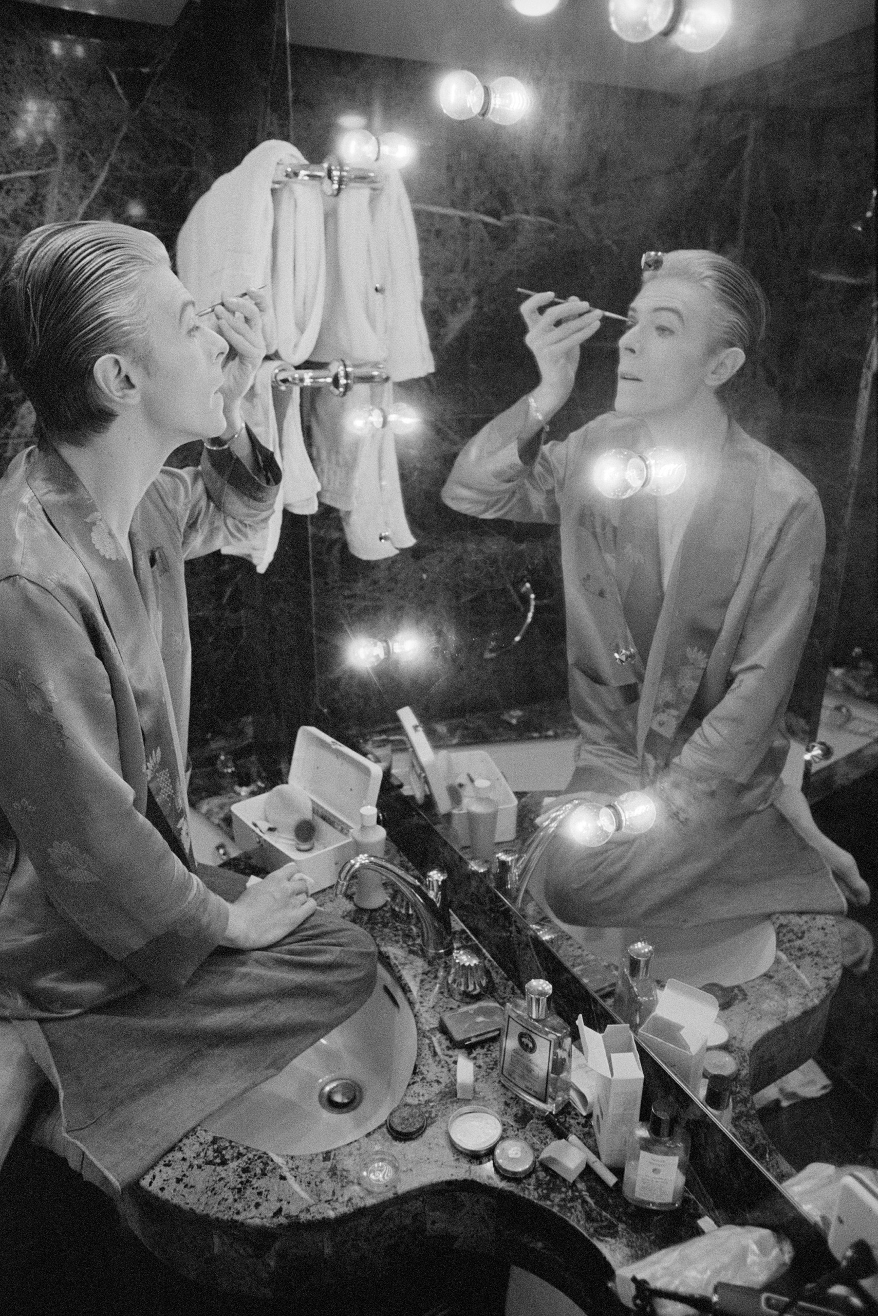Bowie prepares his makeup in his Paris hotel suite prior to an impromptu photo. shoot.