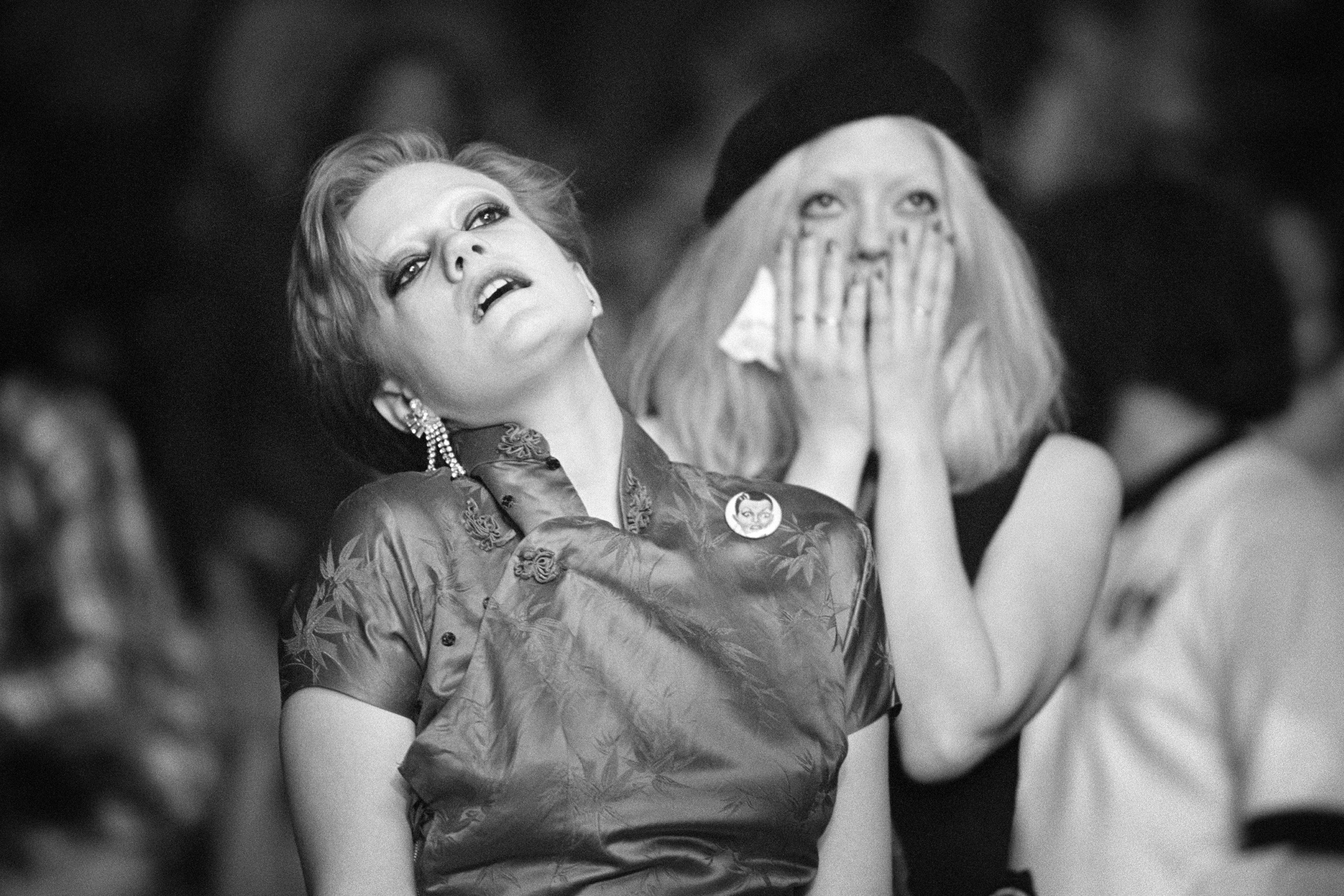 Two super-fans Trixie (L) and Polly (R) who attended nearly every show on the North American Isolar tour, react to Bowie on stage in Los Angeles,1976.