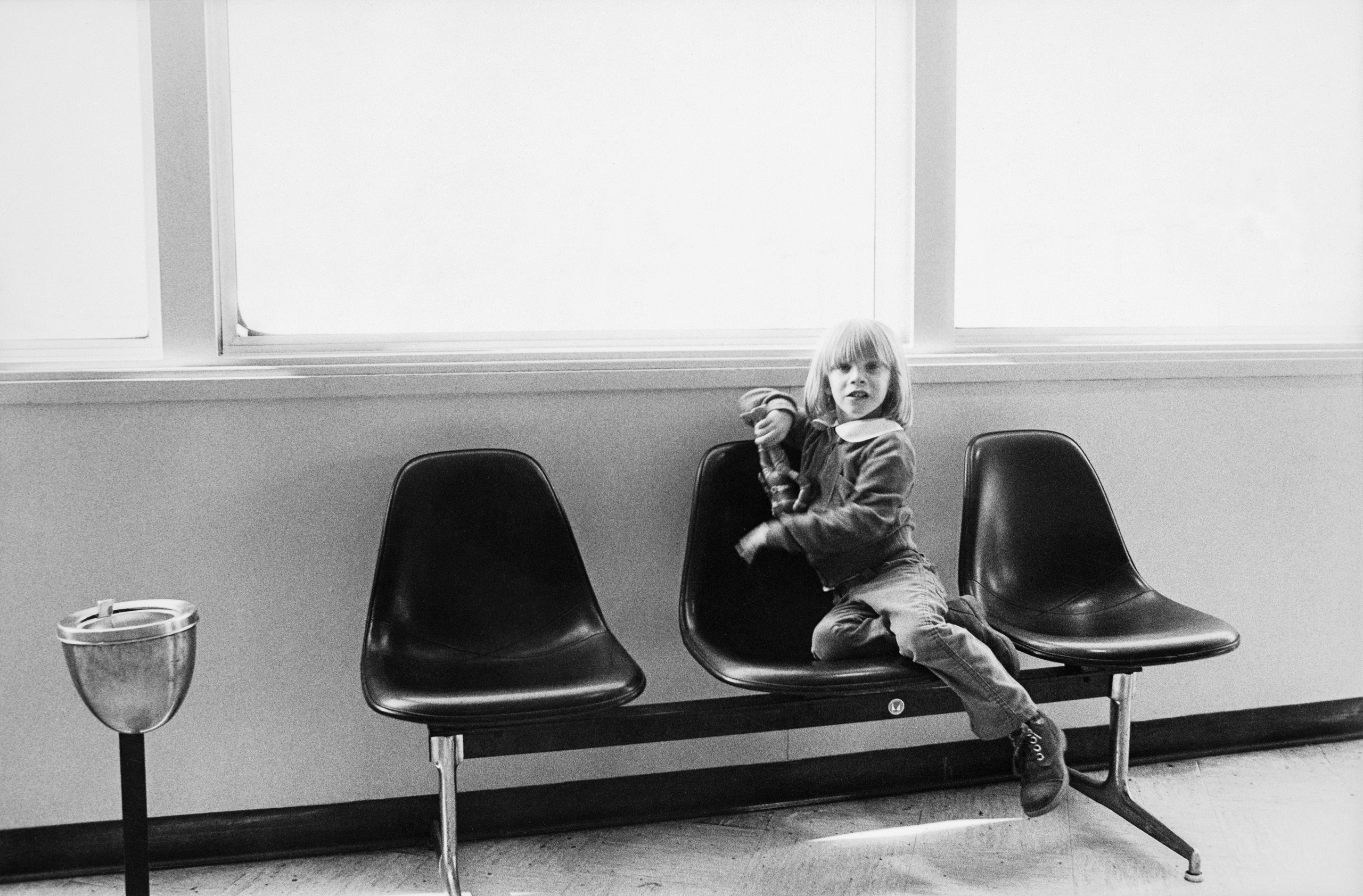 Five year old Zowie (Duncan Jones) plays with his  action figure in an airport lounge between stops on the Isolar tour.