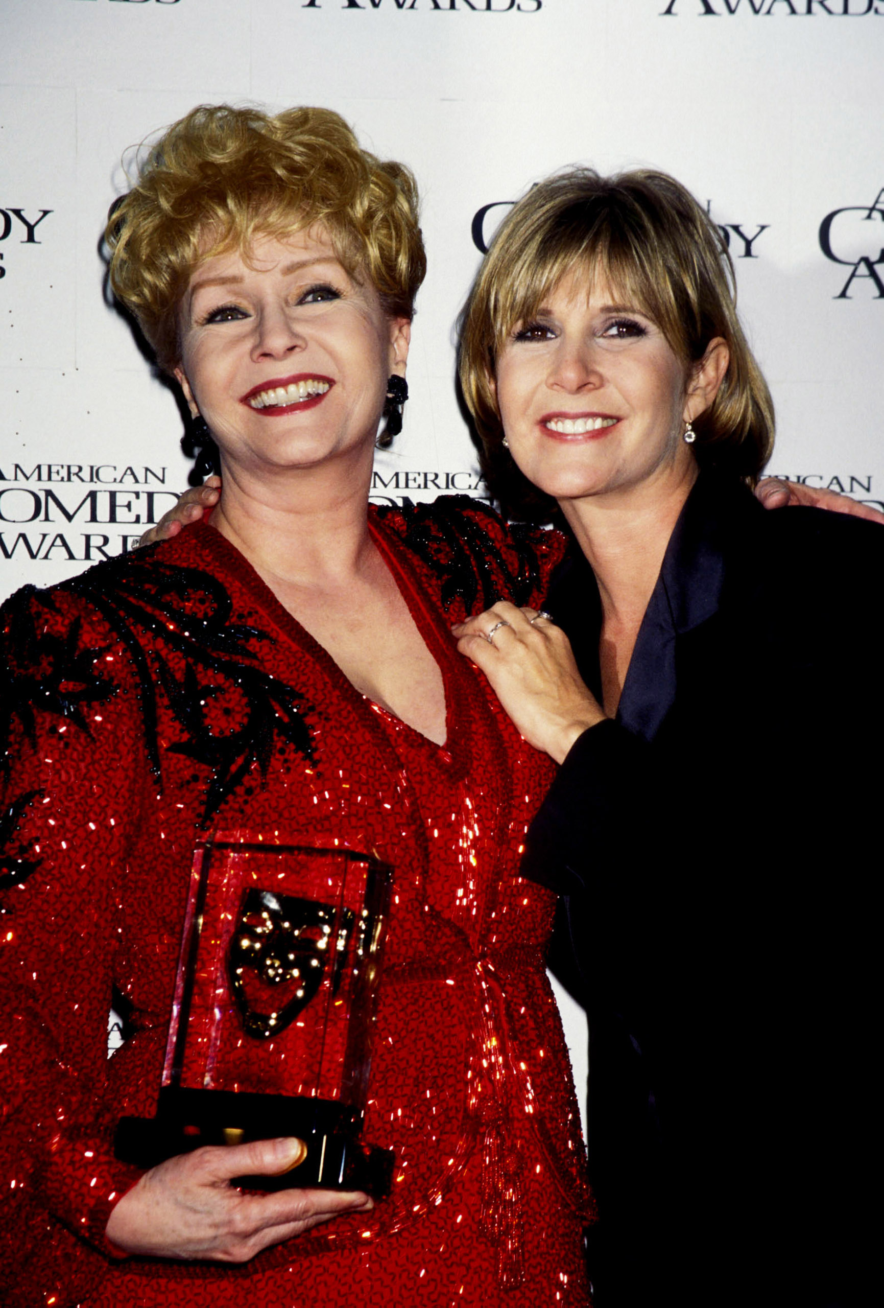 Debbie Reynolds and Carrie Fisher during 11th Annual American Comedy Awards at The Shrine Auditorium in Los Angeles, California, United States.
