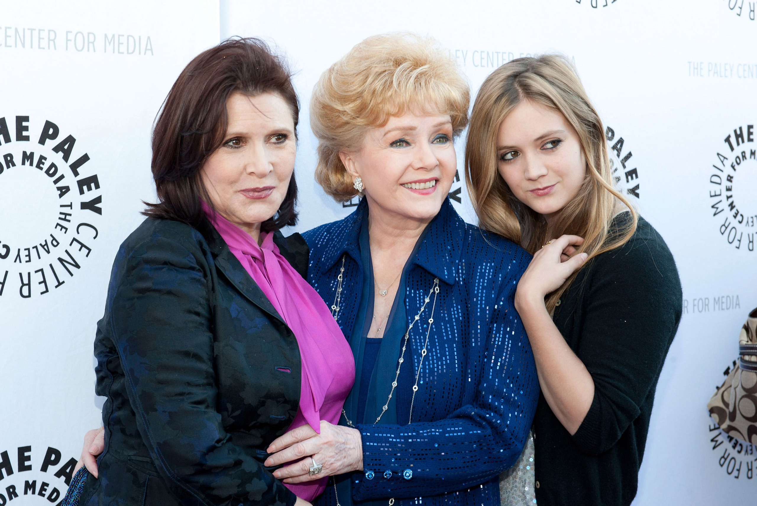 (L-R) Actress and writer Carrie Fisher, her mother Debbie Reynolds and daughter Billie Lourd arrive at a reception at the Paley Center for Media celebrating the exhibit  Debbie Reynolds' Hollywood Memorabilia, June 7, 2011 in Beverly Hills, California.