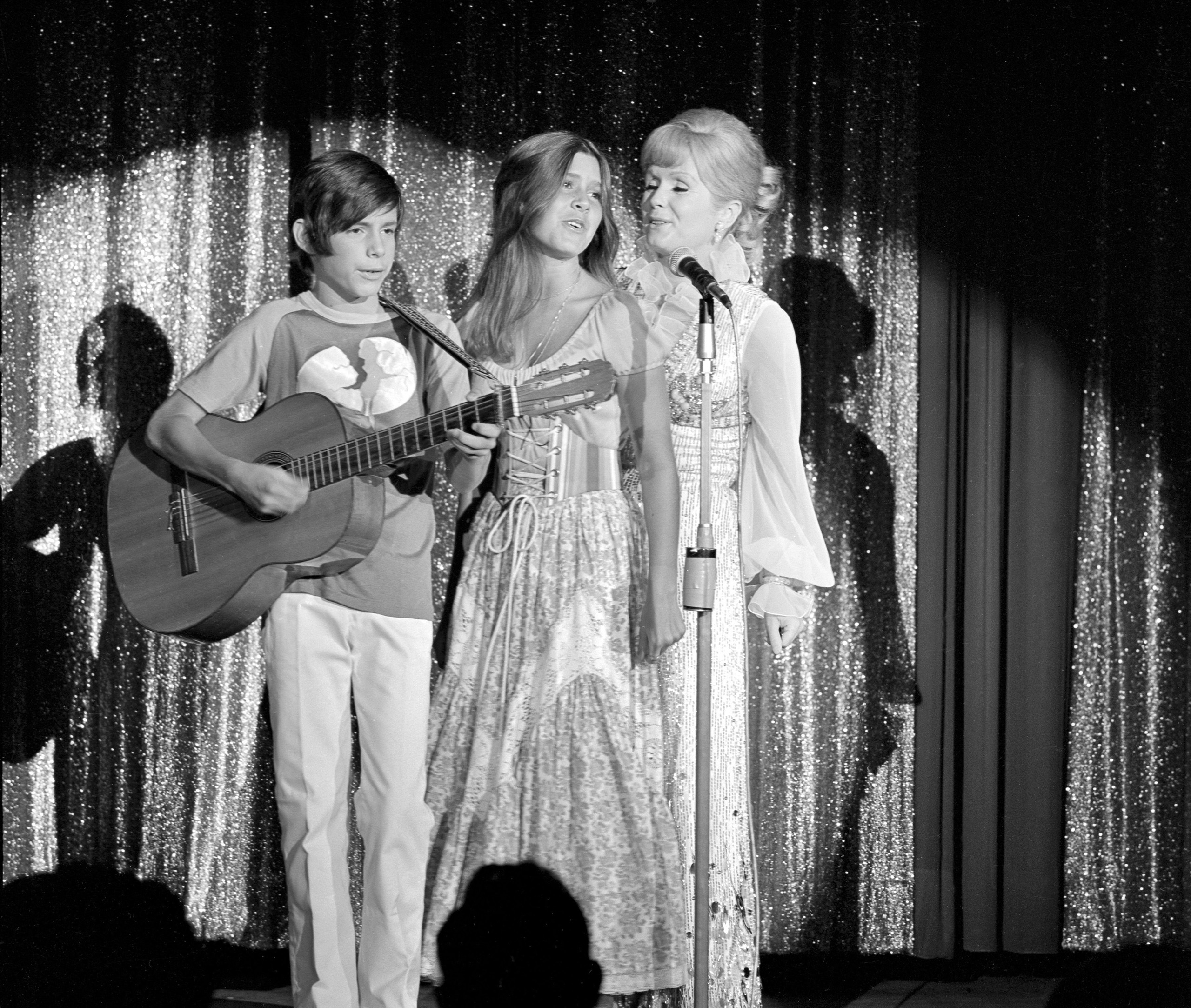 Debbie Reynolds (R) with her daughter Carrie Fisher (C) and son Todd Fisher (L) on opening night of her Reynolds show run at the Desert Inn in Las Vegas, Nevada, USA, 28 July 1971.