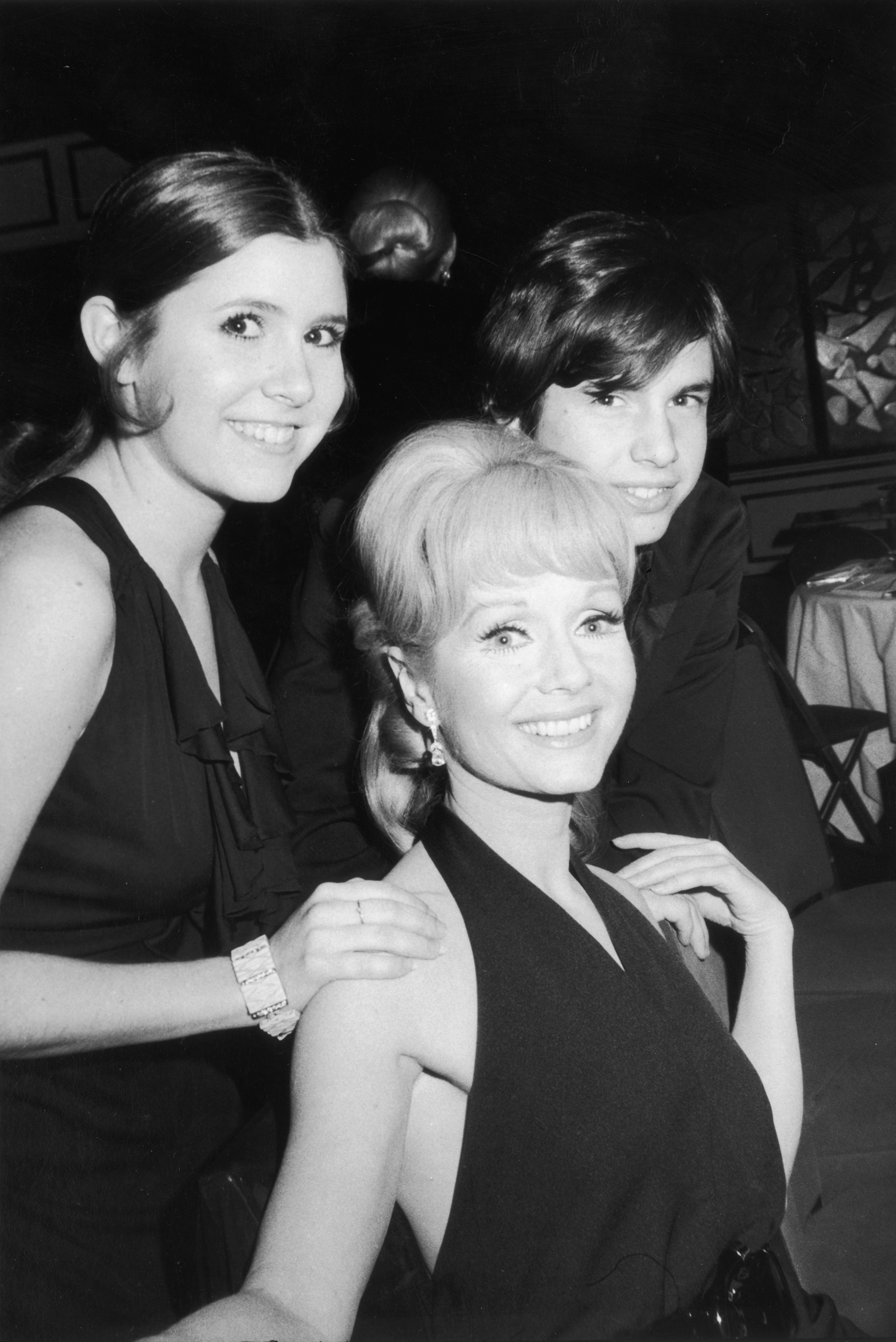 Debbie Reynolds poses her children,  Carrie Fisher and Todd Fisher, as they attend the opening night party for the Broadway musical revival 'Irene,' in which Reynolds starred, New York City, March, 13 1973.