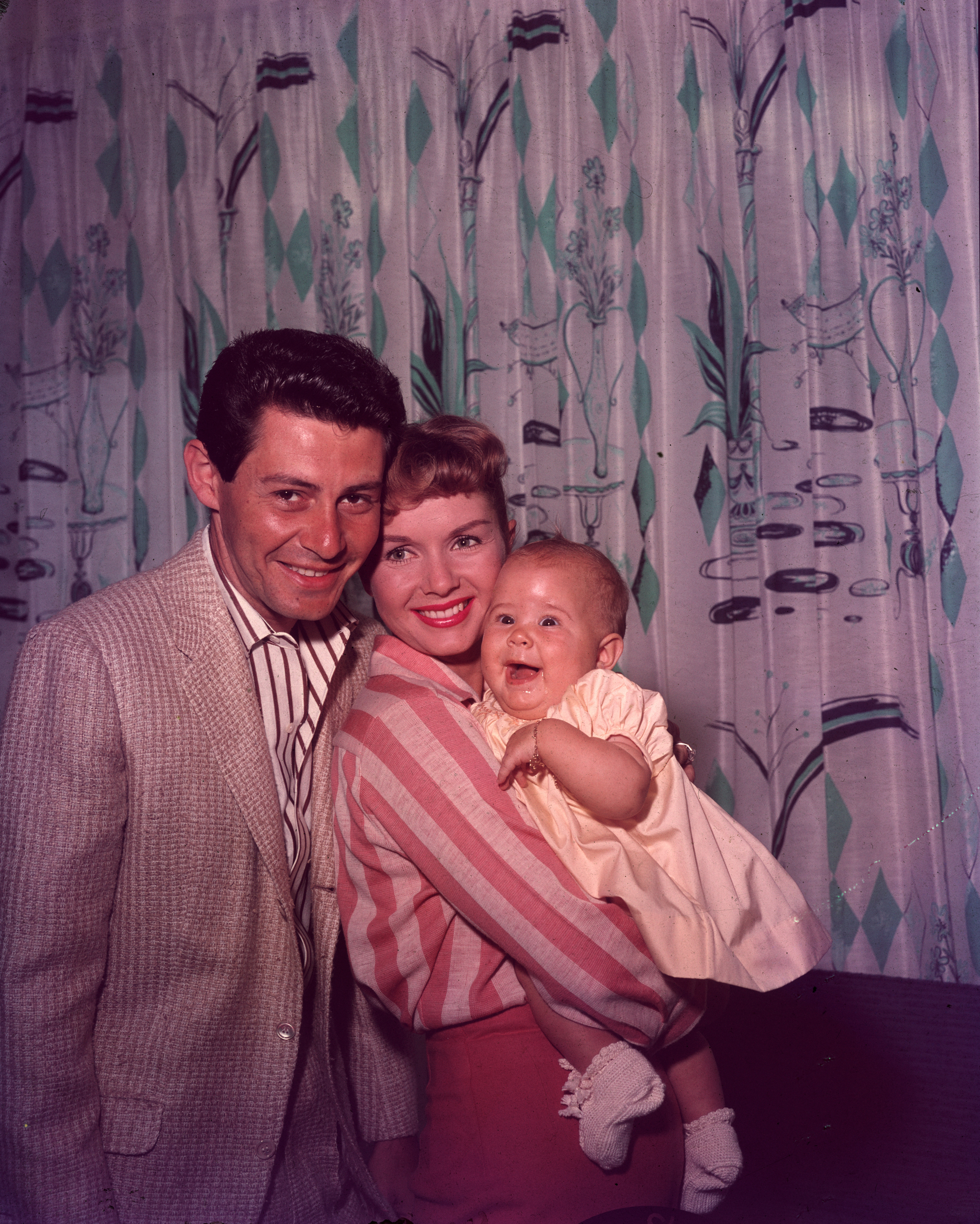 Family portrait of American singer Eddie Fisher and Debbie Reynolds with their daughter Carrie Fisher.