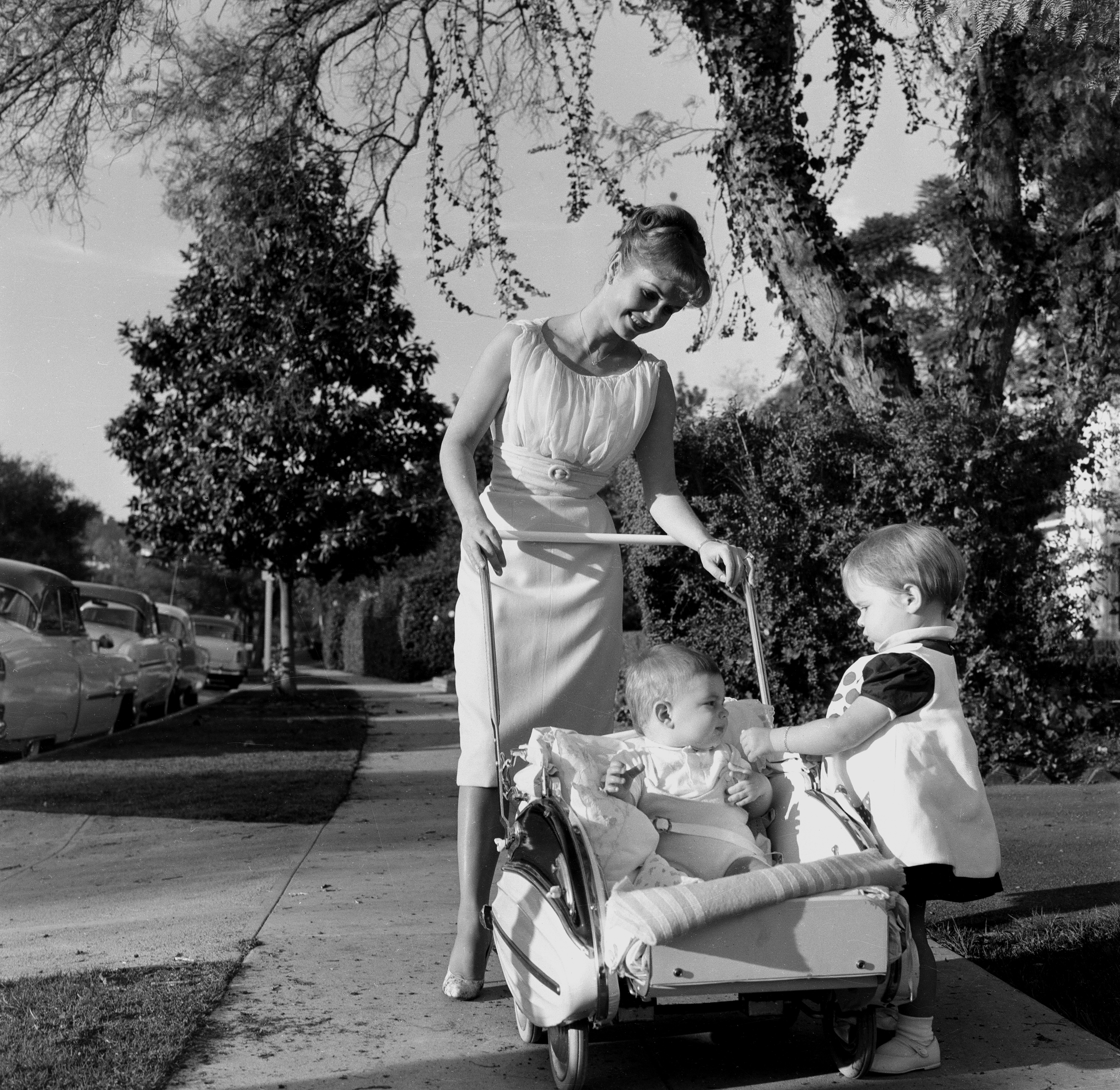 Actress Debbie Reynolds takes a walk with her children Carrie Fisher and Todd Fisher at home in Los Angeles,CA,