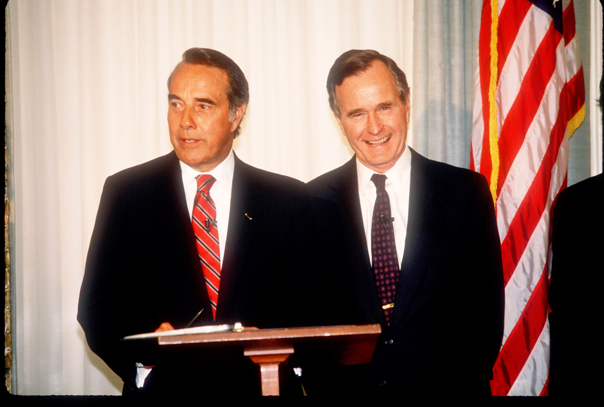 George Herbert Walker Bush stands with Bob Dole in Washington, D.C., on April 15, 1988.