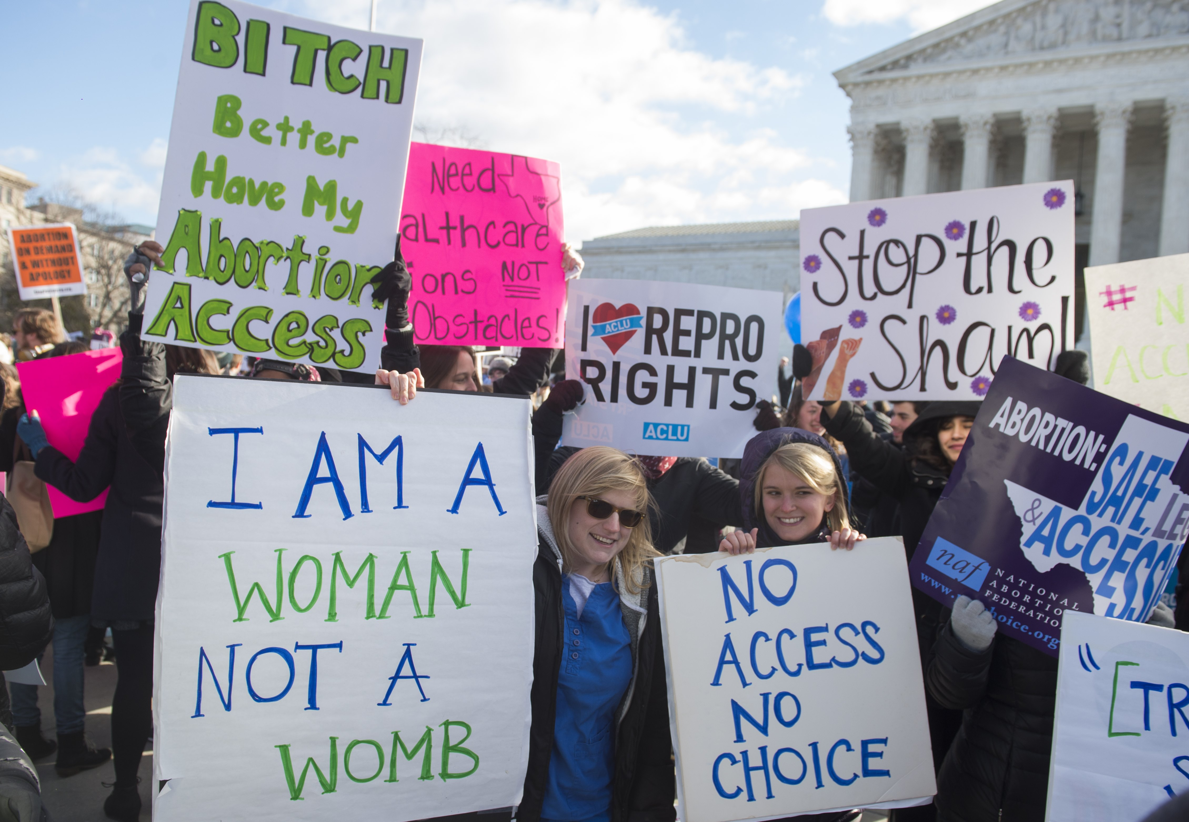 Supporters of legal access to abortion rally outside the Supreme Court in Washington, DC, March 2, 2016, as the Court hears oral arguments in the case of Whole Woman's Health v. Hellerstedt, which deals with access to abortion.