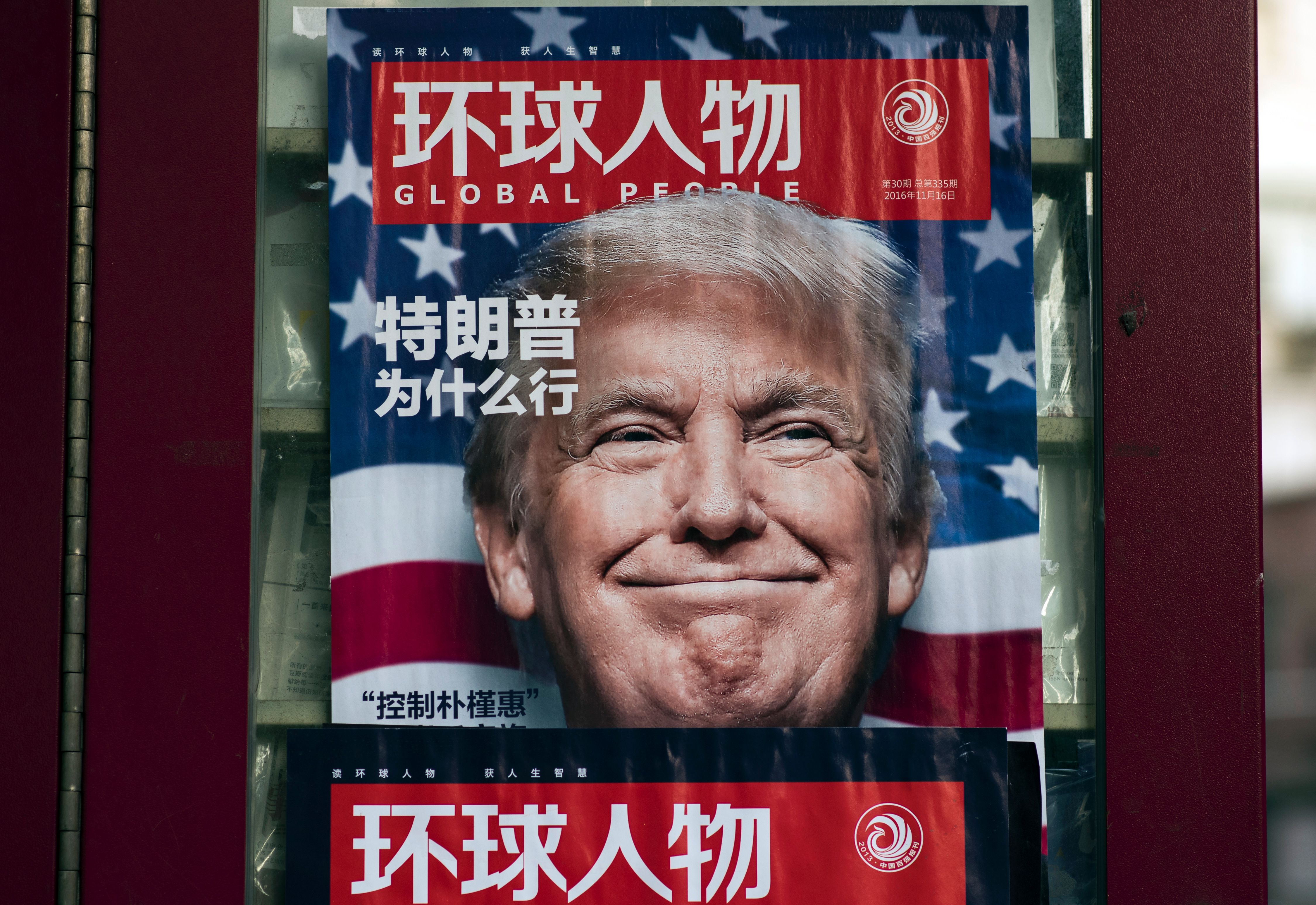 An advertisement for a magazine featuring U.S. President-elect Donald Trump on the cover at a news stand in Shanghai on December 14, 2016.