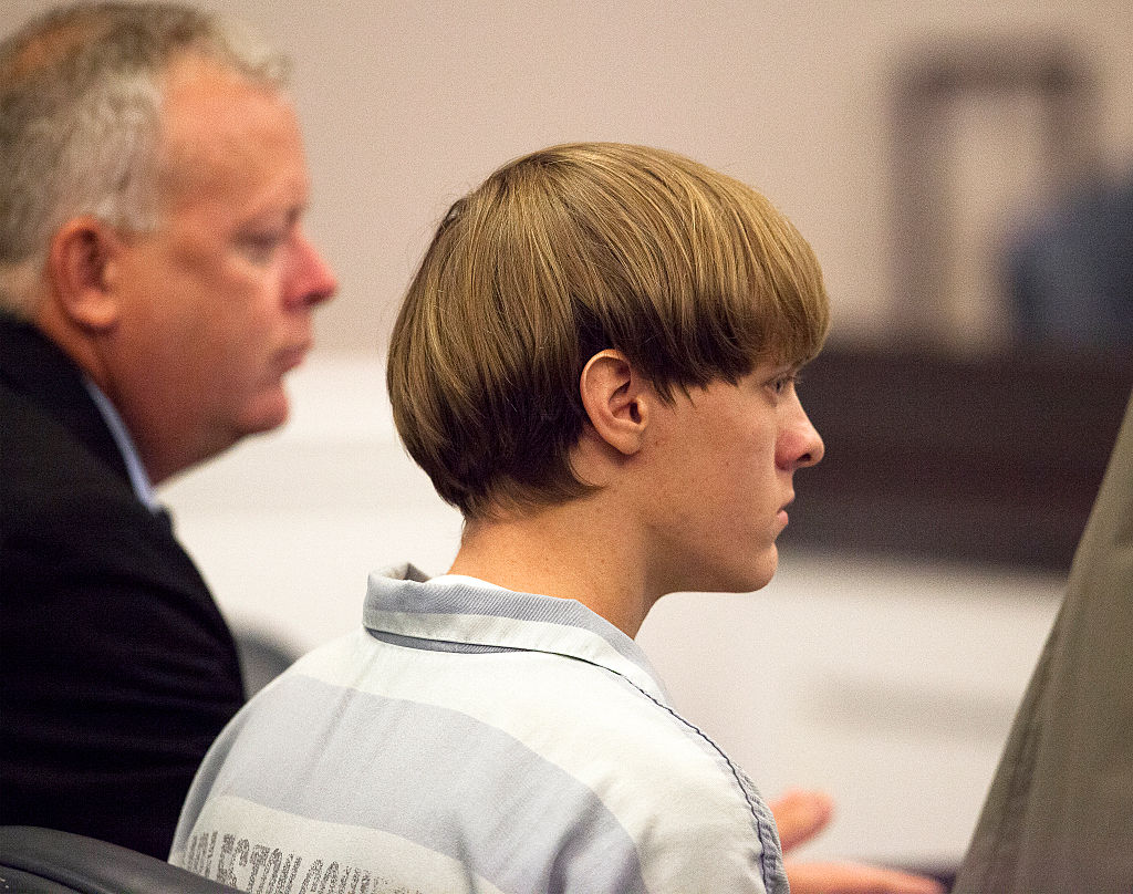 Dylann Roof, 21, listens to proceeding with assistant defense attorney William Maguire during a hearing at the Judicial Center in Charleston, S.C., on July 16, 2015.