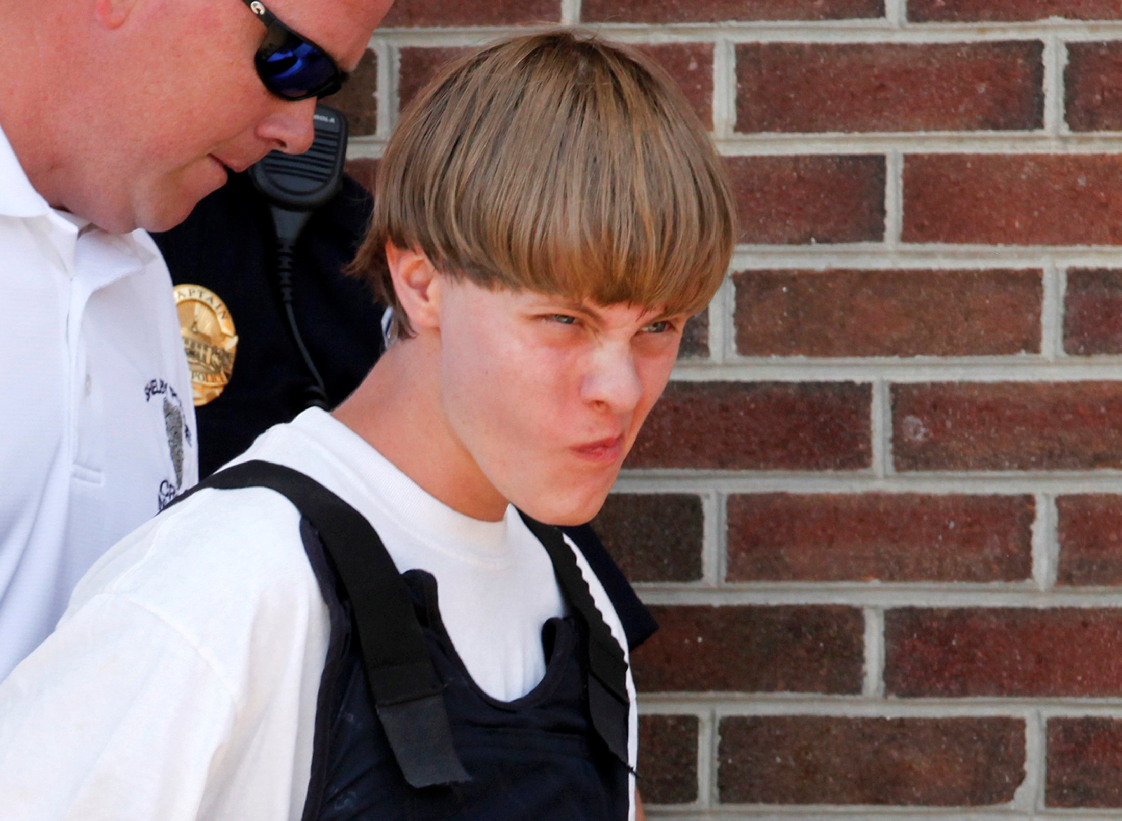 Police lead Dylann Roof into the courthouse in Shelby, NC, June 18, 2015.