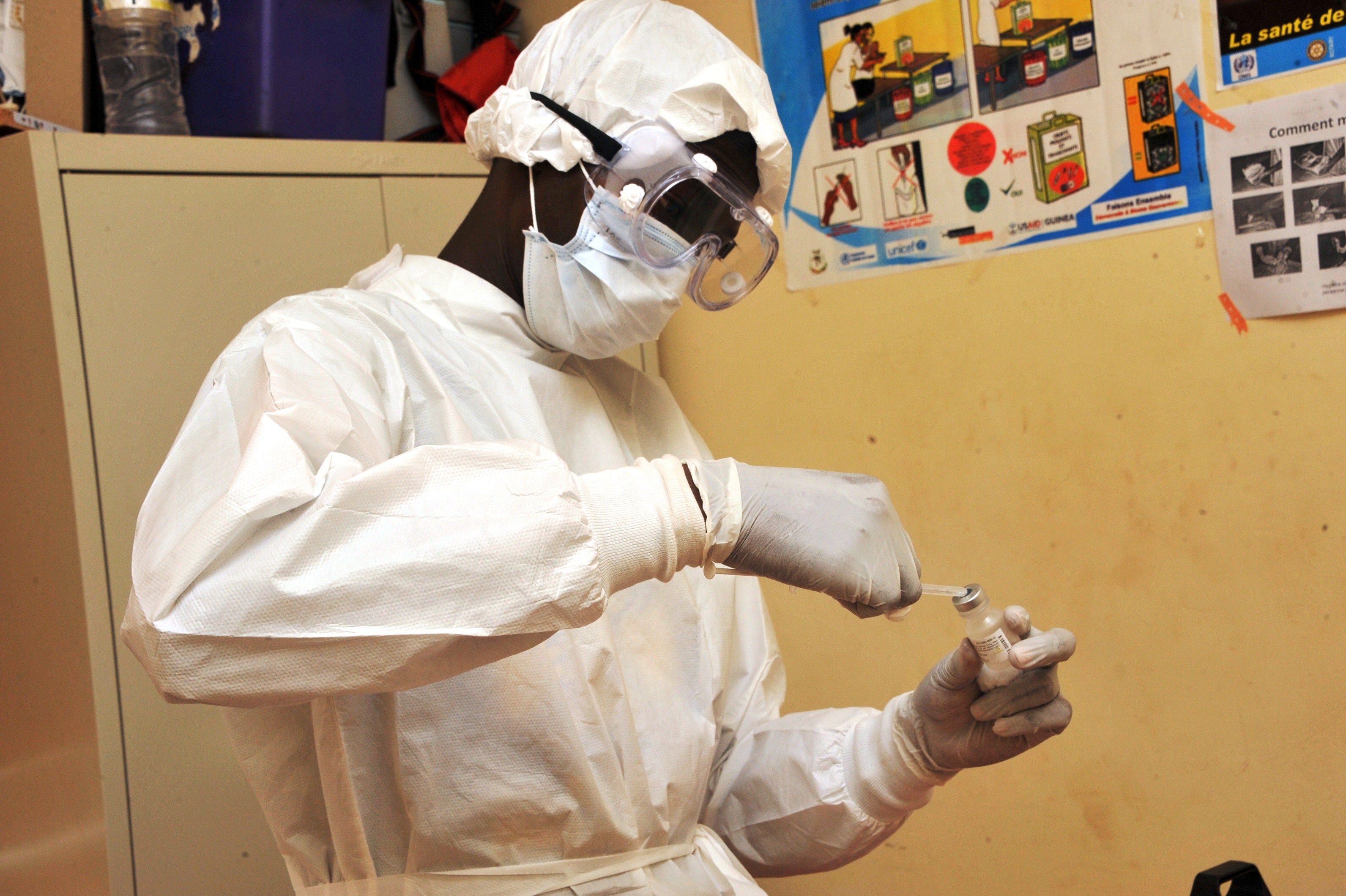 A health worker prepares a vaccination on March 10, 2015 at a health center in Guinea during the first clinical trials of an ebola vaccine.