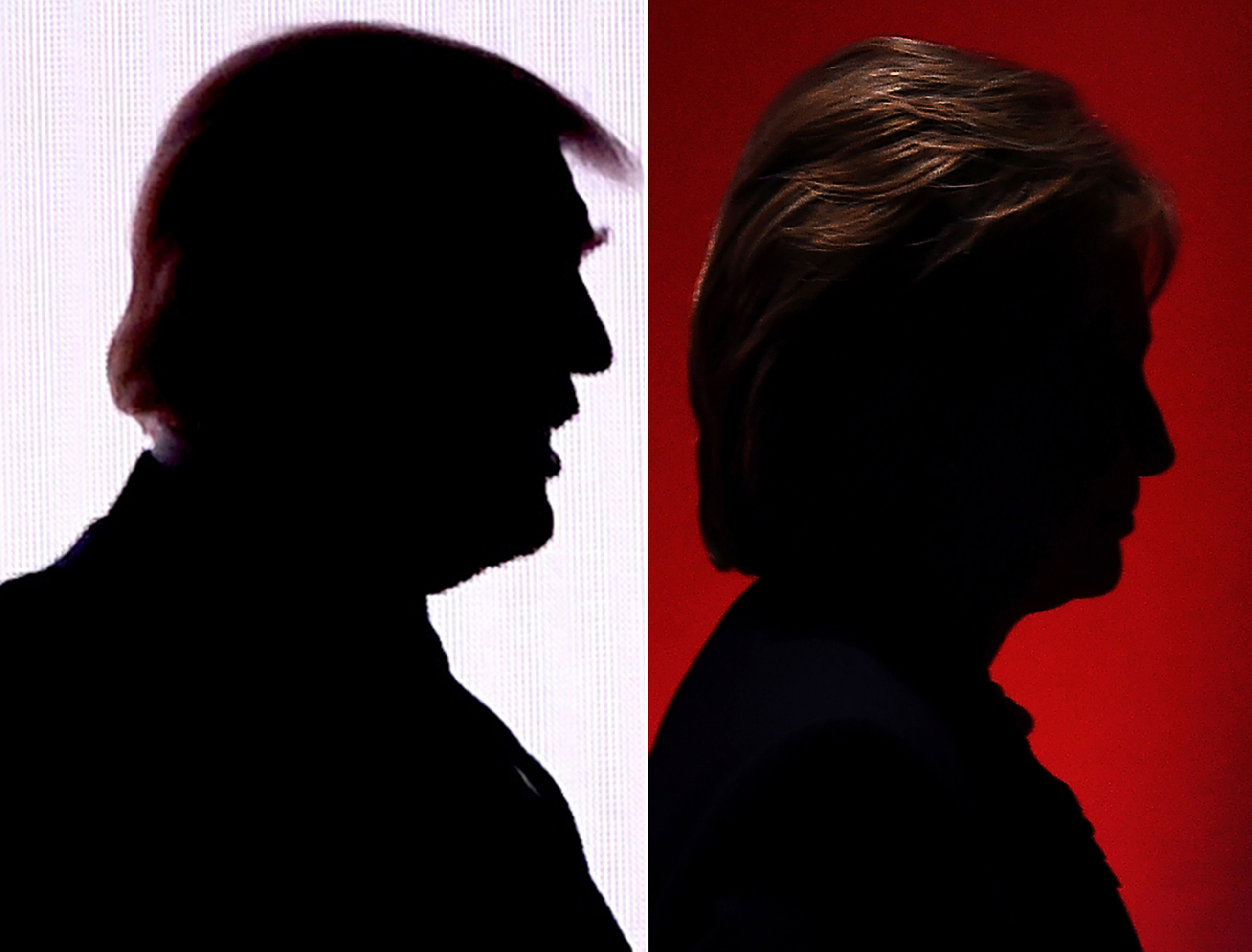 This combination photo shows the silhouettes of Republican presidential nominee Donald Trump on July 18, 2016 and Democratic presidential nominee Hillary Clinton on February 4, 2016.