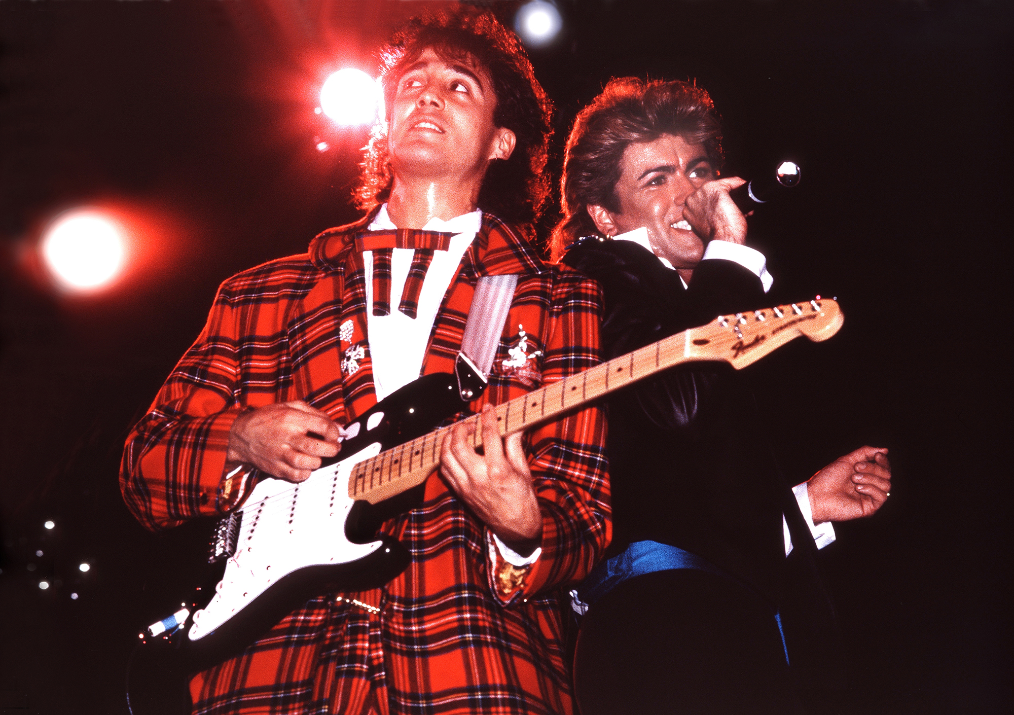 Andrew Ridgeley and George Michael of Wham! perform in London in 1984.