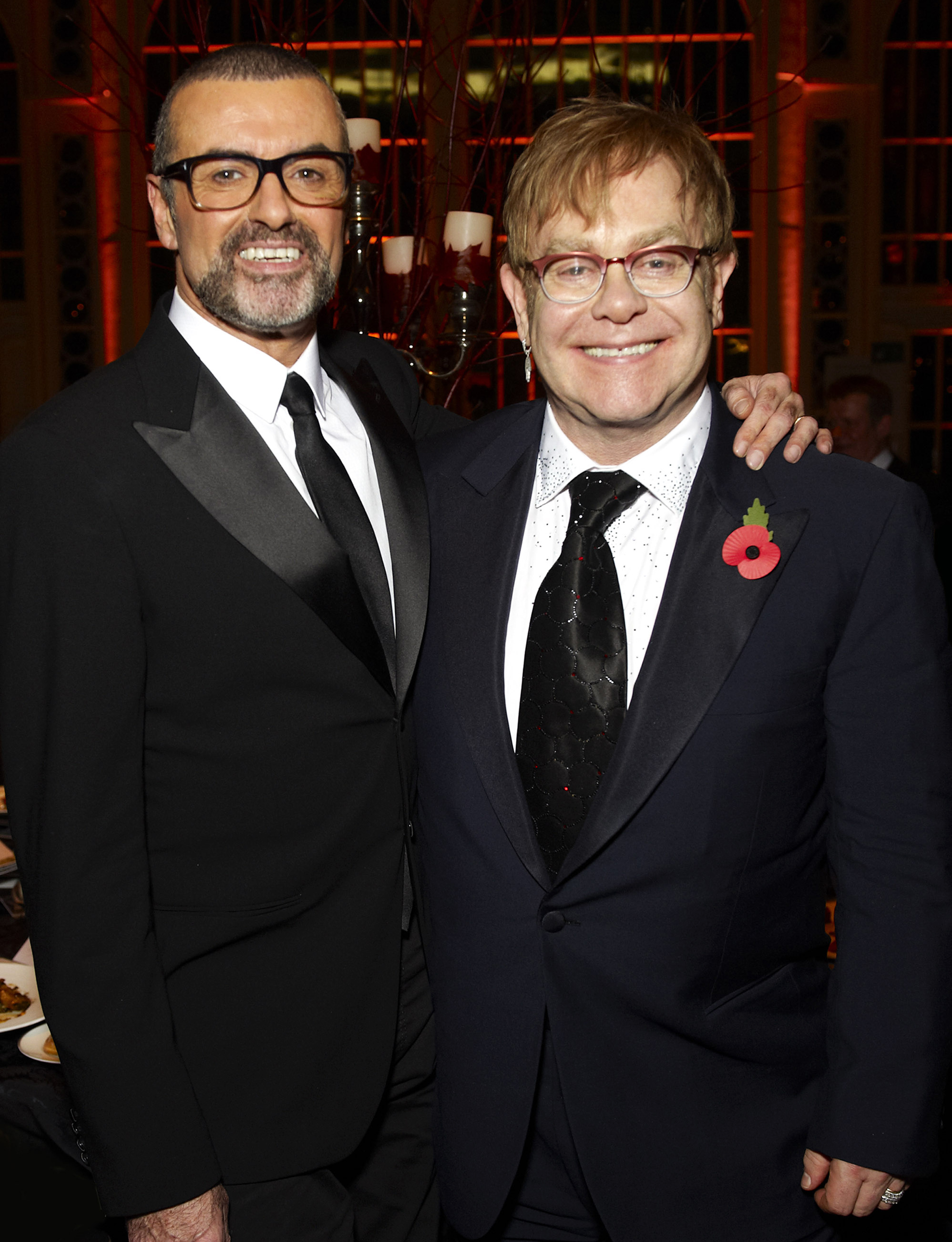 George Michael and Elton John attend a charity performance benefiting the Elton John AIDS Foundation in London, on Nov. 6, 2011.