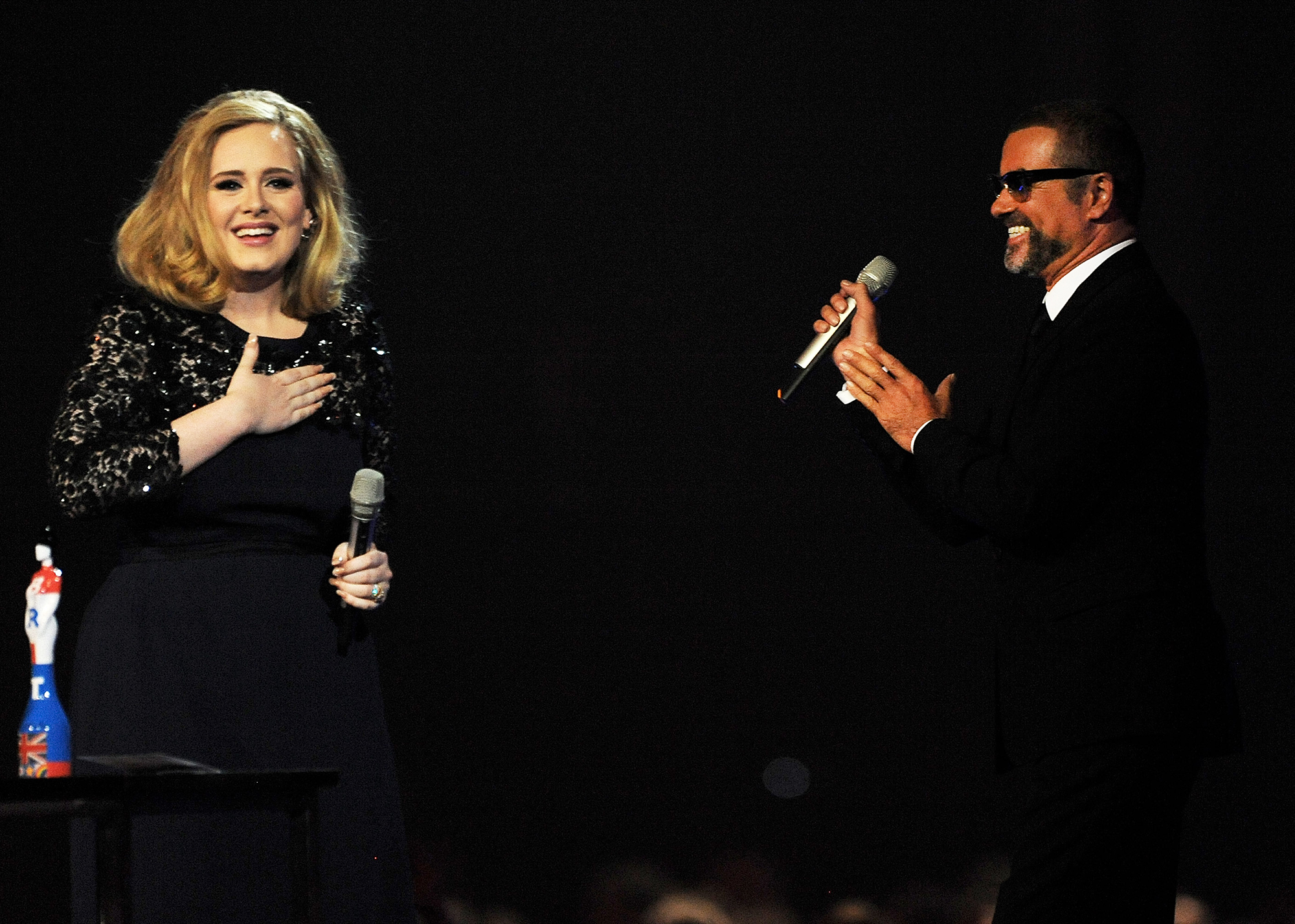 Adele accepts the Best Album award from George Michael during the BRIT Awards at the O2 Arena in London, on Feb. 21, 2012.