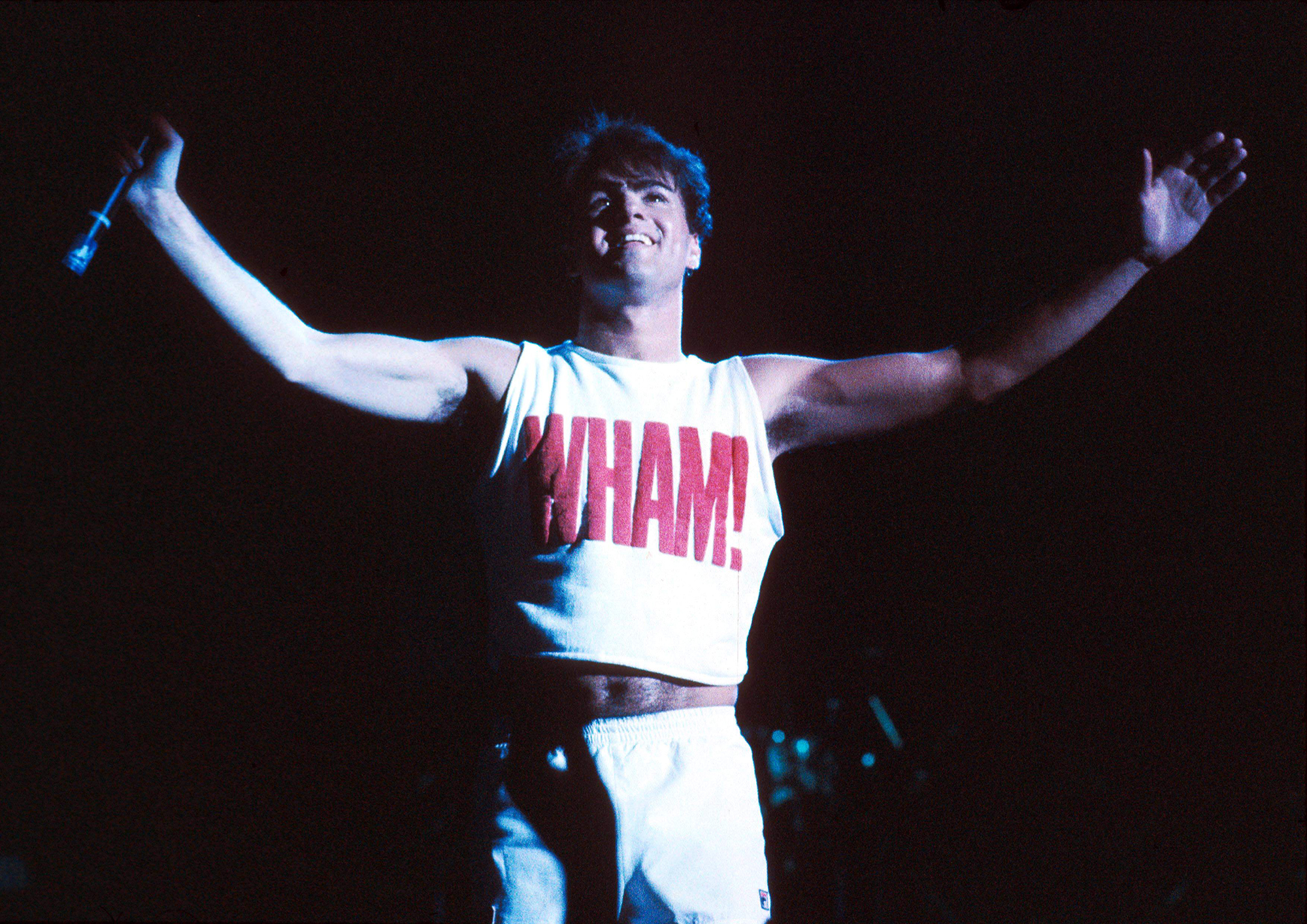 George Michael performs with Wham!, on Oct. 1, 1983.