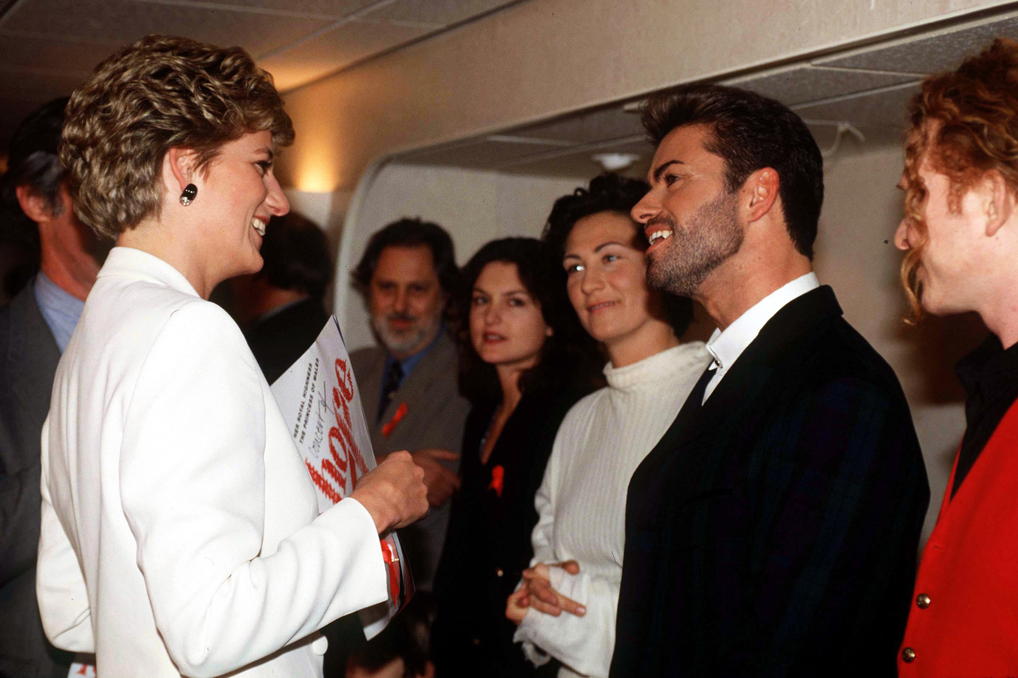 Princess Diana speaks with George Michael at The World Aids Day Annual  Concert of Hope  at Wembley Arena in London, on Dec. 1 1993.
