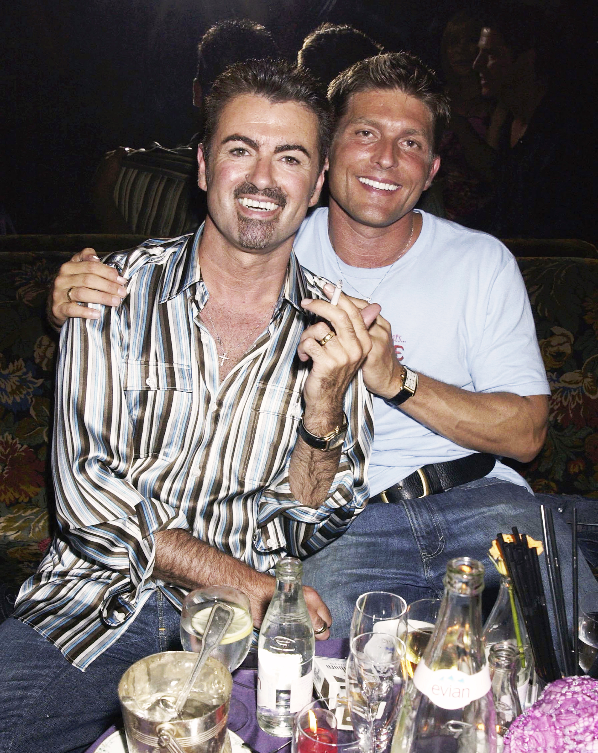 George Michael and partner Kenny Goss at the Versace Couture launch party in Paris, on July 9, 2002.