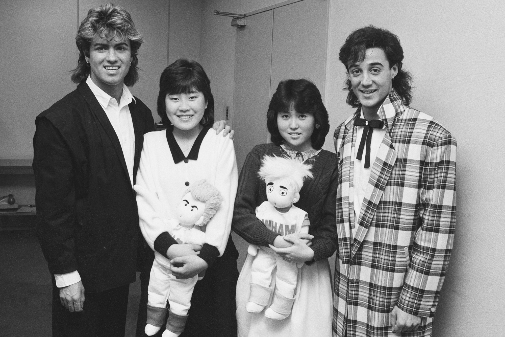George Michael and Andrew Ridgeley of Wham! with two fans during their 1985 world tour in Japan.
