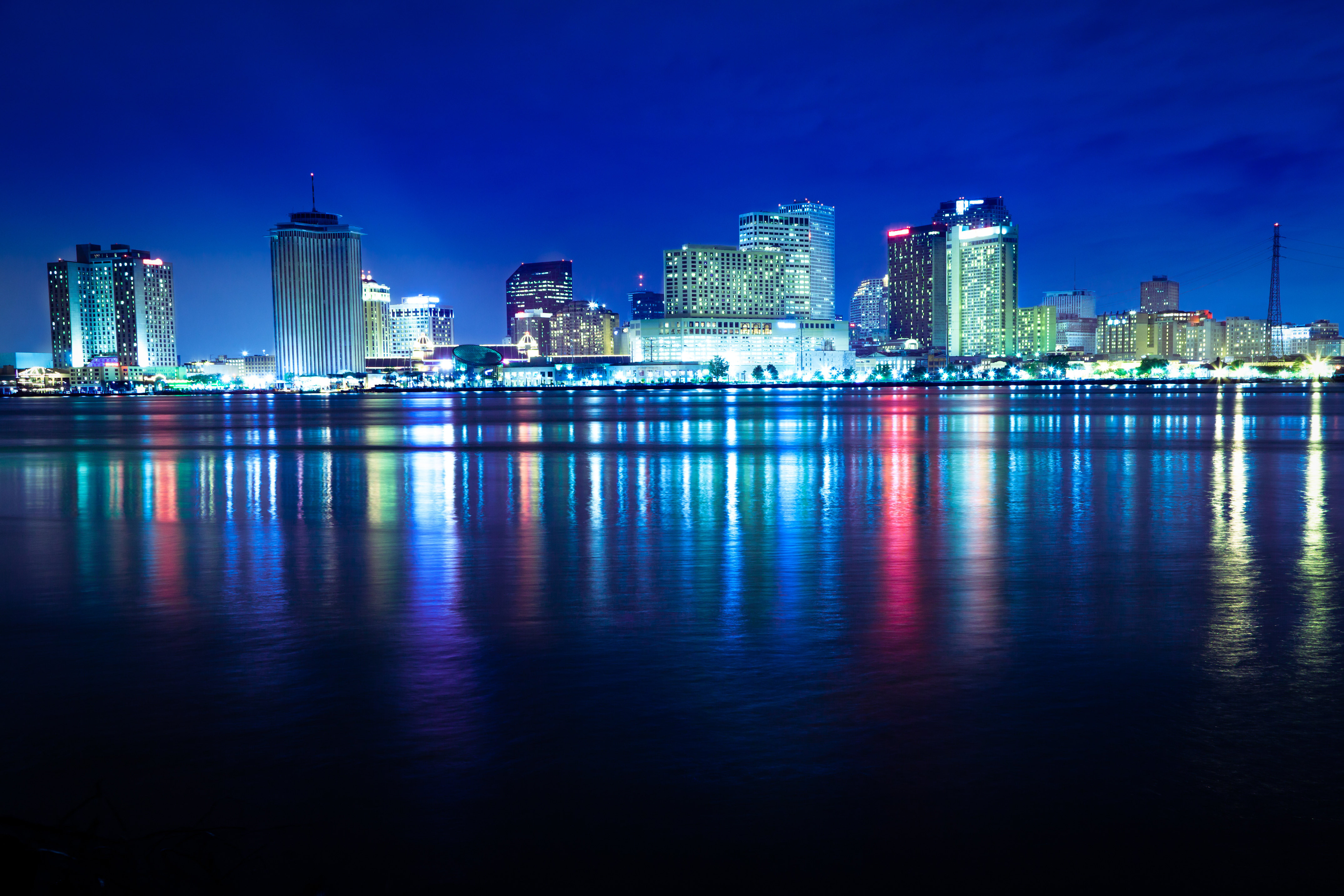 The New Orleans skyline reflects on the Mississippi River.