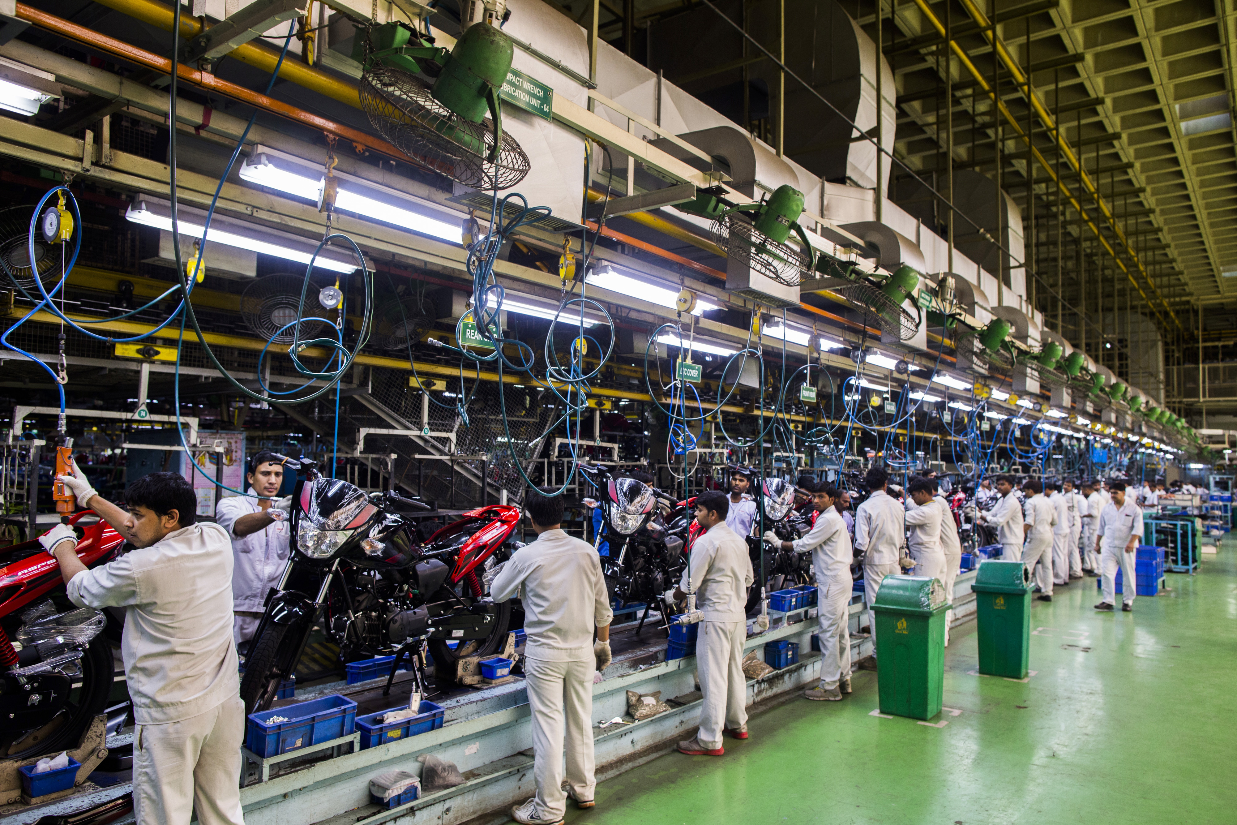 Workers assemble Hero Ignitor motorcycles on the assembly line of the Hero MotorCorp Ltd. manufacturing facility in Gurgaon, India, on June 11, 2014.