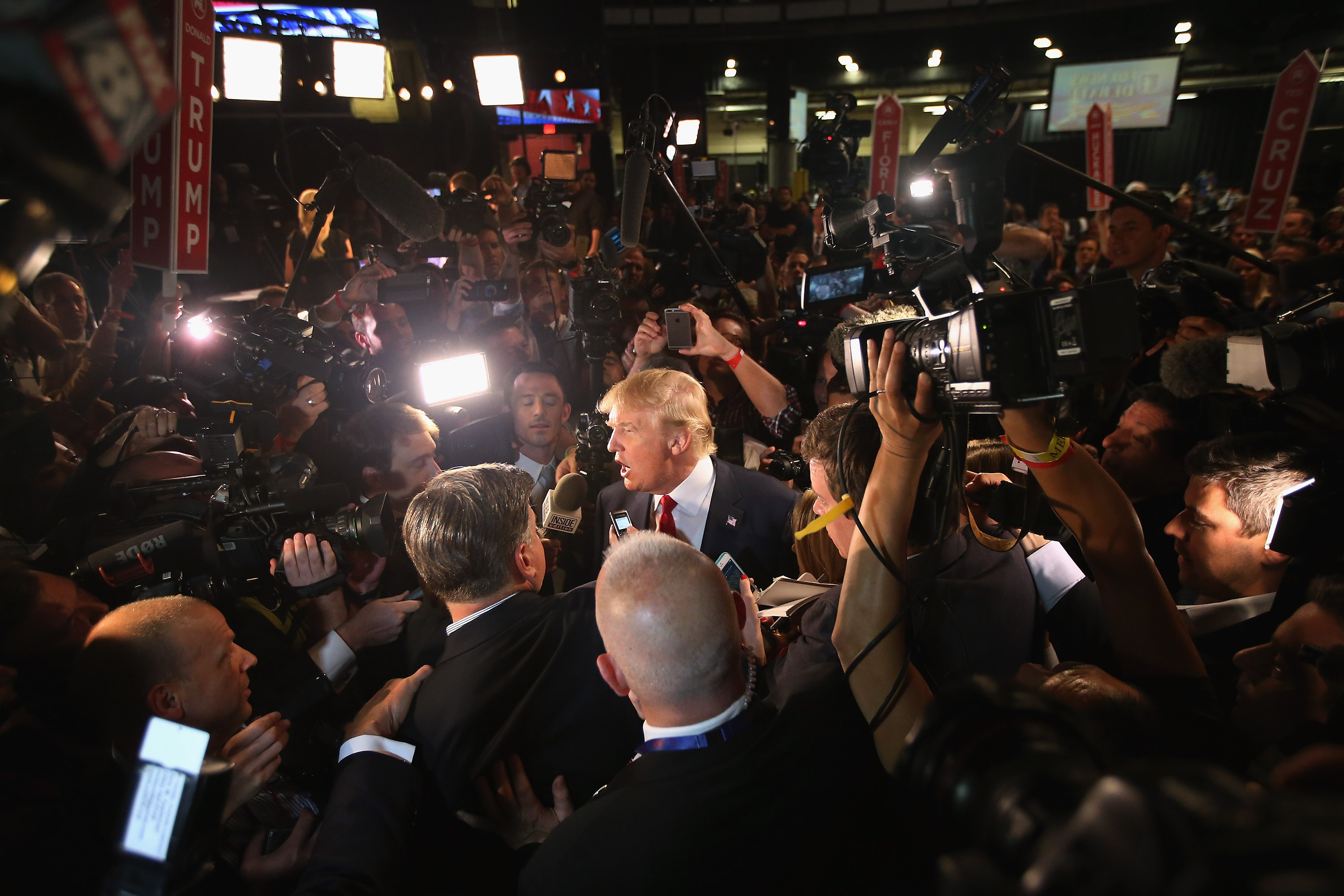 Republican presidential candidate Donald Trump (C) talks to reporters in the 'Spin Alley' after the first prime-time presidential debate hosted by FOX News and Facebook at the Quicken Loans Arena on Aug. 6, 2015 in Cleveland.