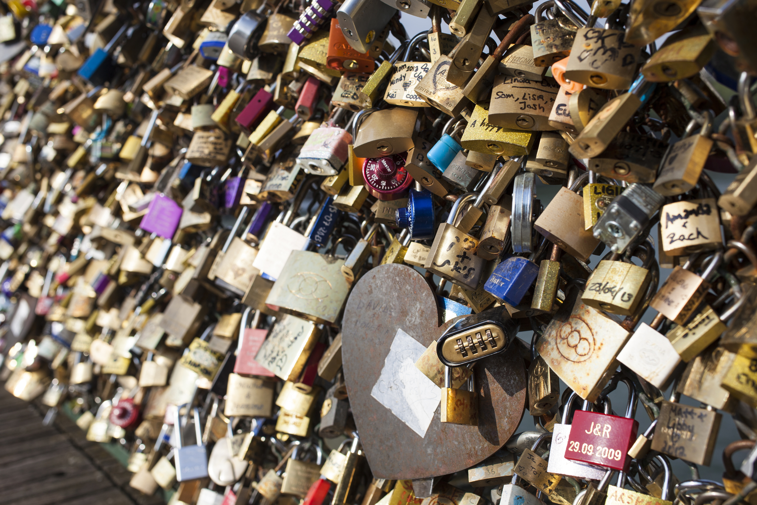 Love padlocks are attached to the railing of the bridge Le Pont des Arts in Paris, France.  The city's environment chief announced the sale of the locks last week.