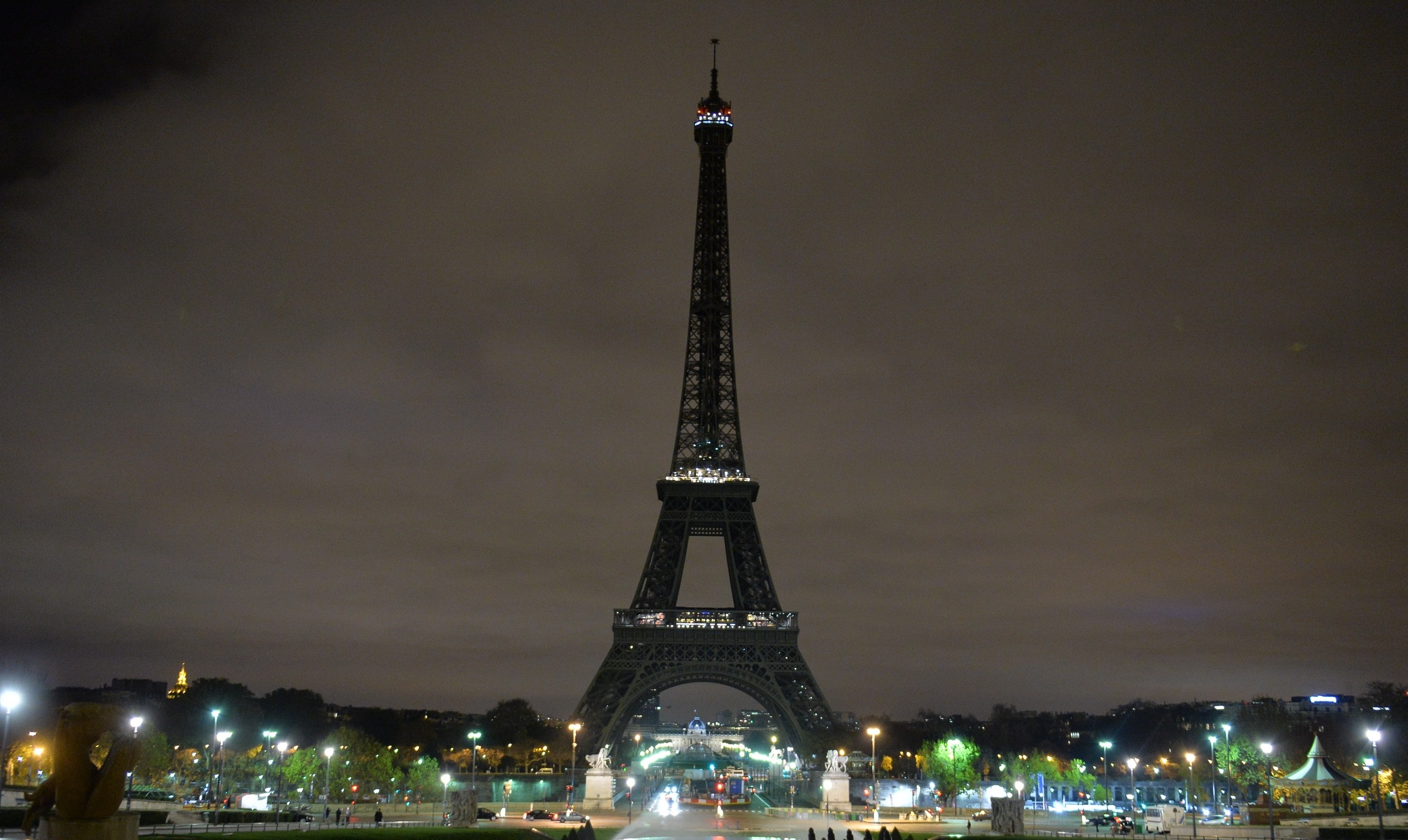 The Eiffel Tower is seen after turning off its lights in respect for the victims of France terror attacks, on Nov. 14, 2015.