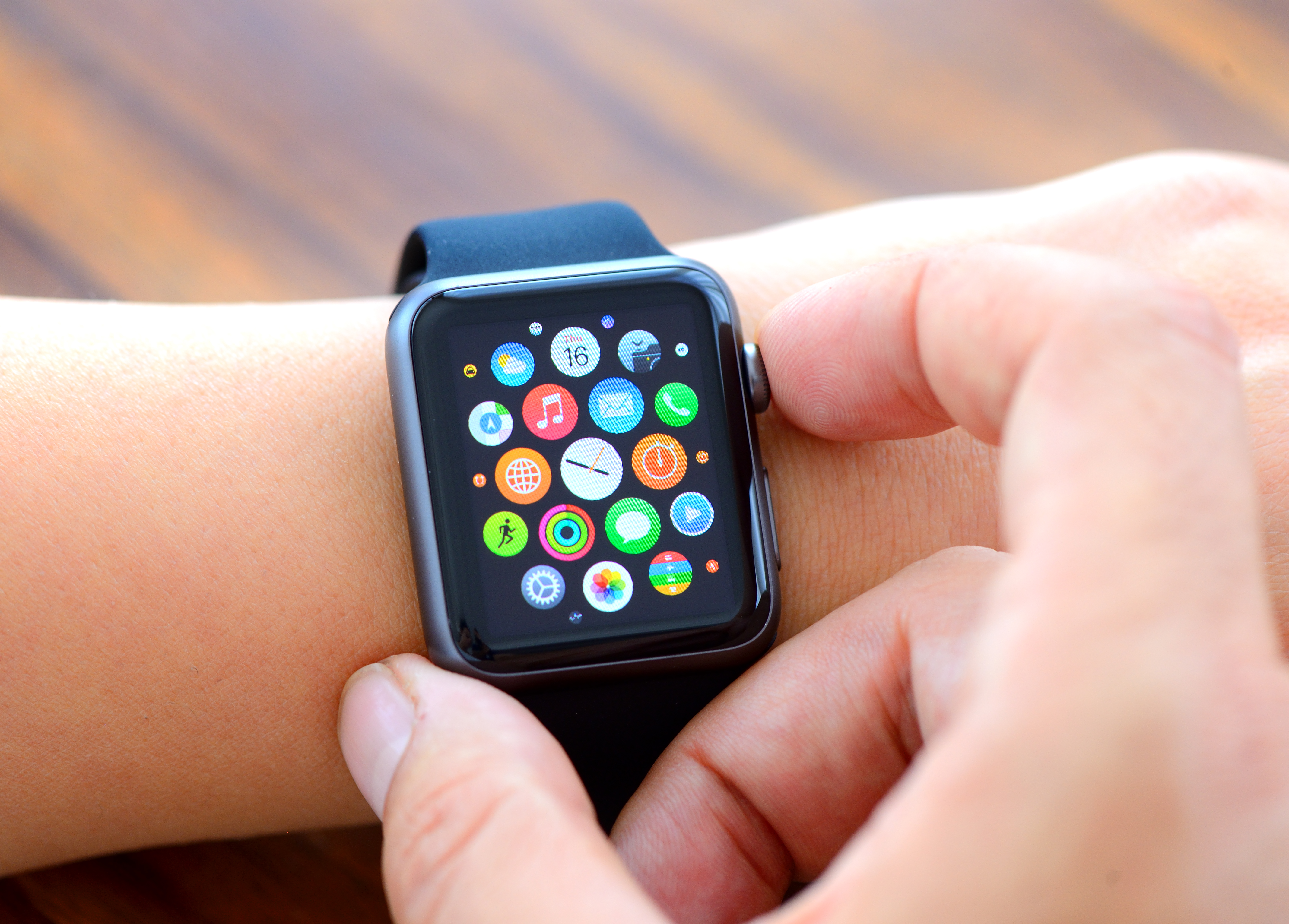 CEO Tim Cook says sales of the Apple Watch set a record during the first week of holiday shopping.