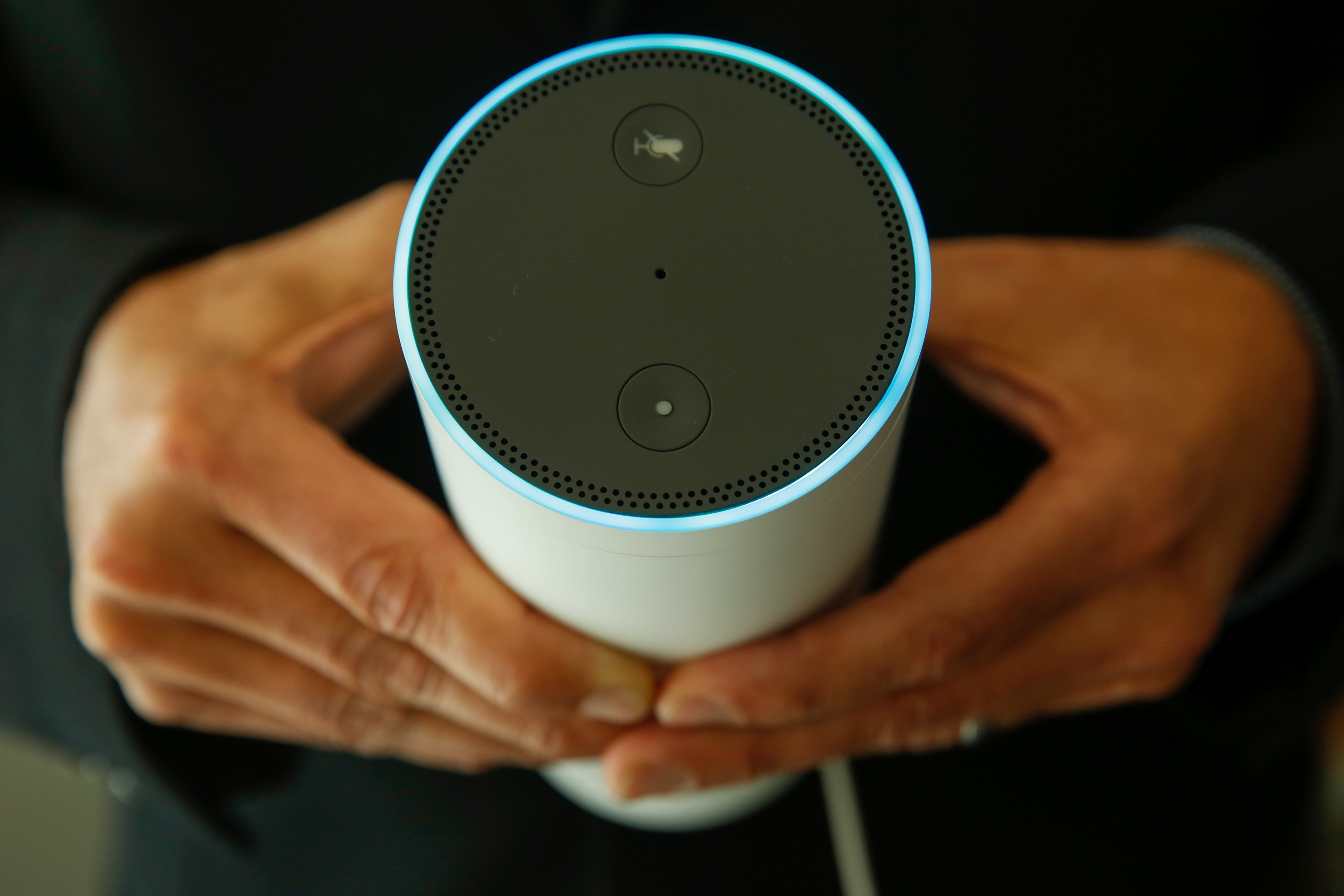 An attendee holds an Echo device during the U.K. launch event for the Amazon.com Inc. Echo voice-controlled home assistant speaker in this arranged photograph in London, U.K., on Wednesday, Sept. 14, 2016.
