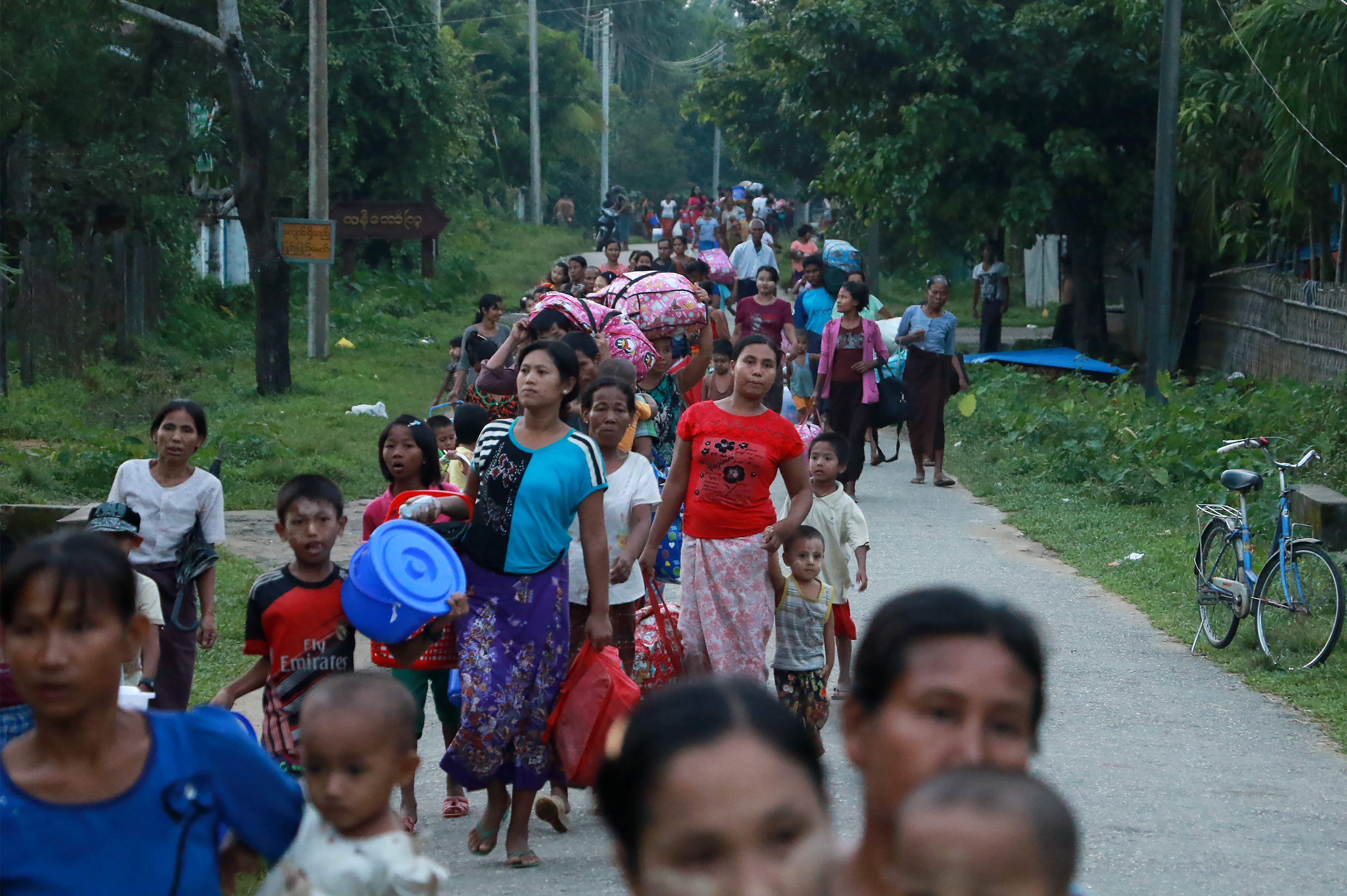 Residents displaced by conflict flee from Maungdaw, in Burma's Rakhine state, on Oct. 13, 2016