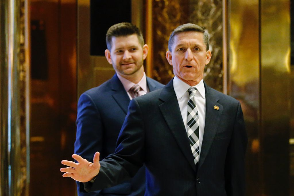 Retired Army three-star general Michael T. Flynn arrives at Trump Tower last month with his son, Michael G. Flynn.