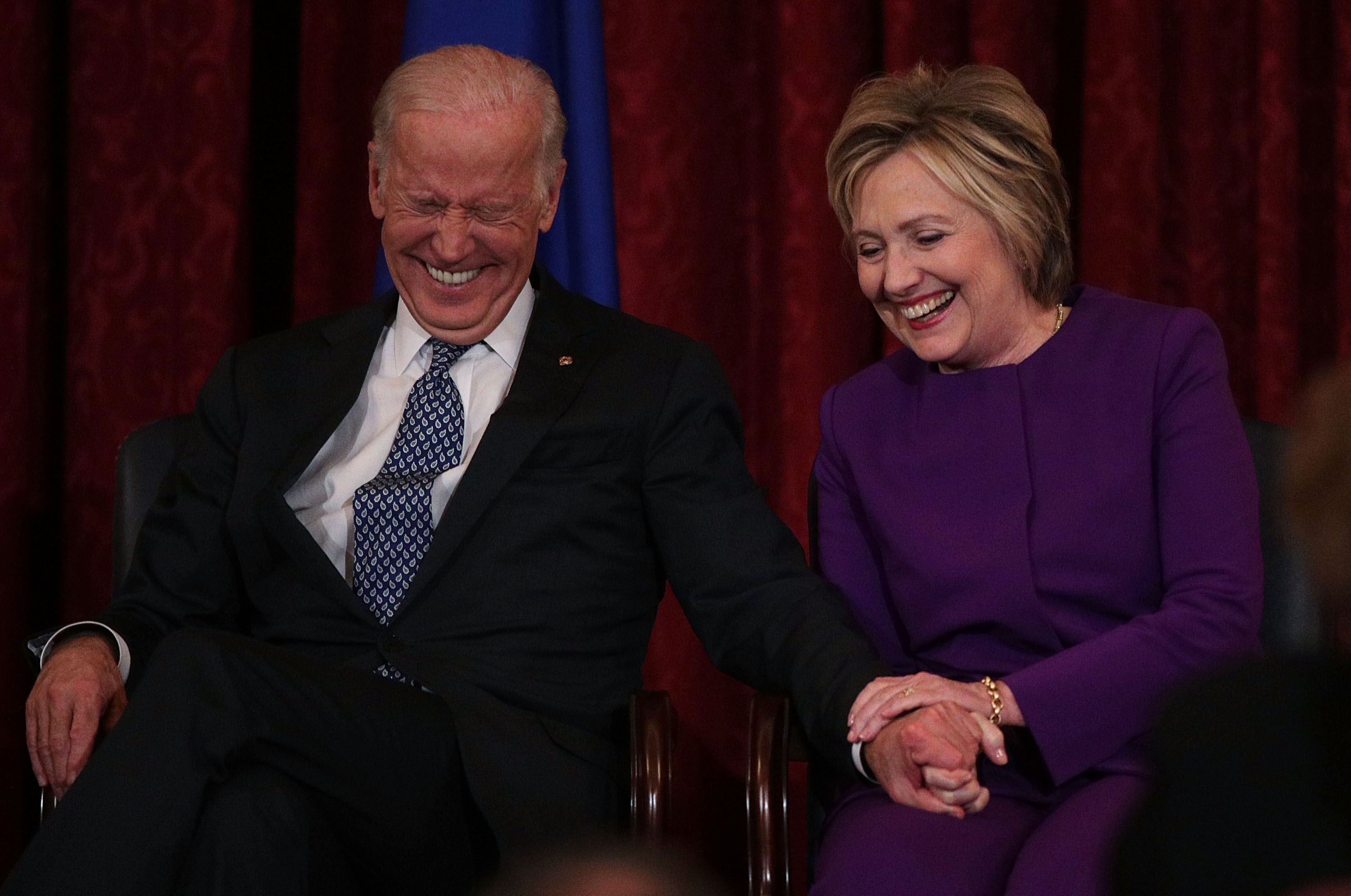 Former U.S. Secretary of State Hillary Clinton (R) shares a moment with Vice President Joseph Biden (L) during a leadership portrait unveiling ceremony for Senate Minority Leader Sen. Harry Reid (D-NV) December 8, 2016 on Capitol Hill in Washington, DC.   (Alex Wong--Getty Images)