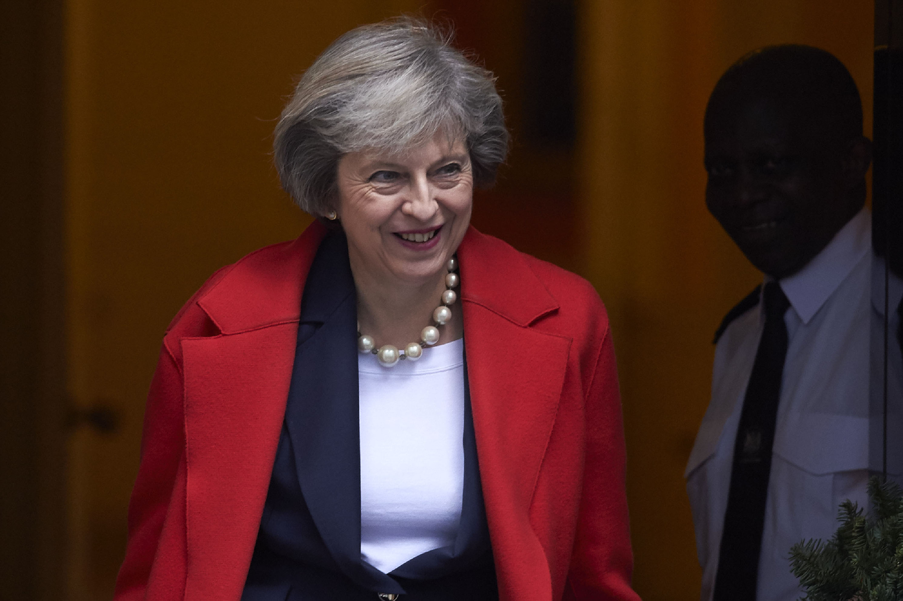 British Prime Minister Theresa May leaves 10 Downing Street in London on Dec. 14, 2016, ahead of the weekly Prime Minister's Questions at the House of Commons in London.