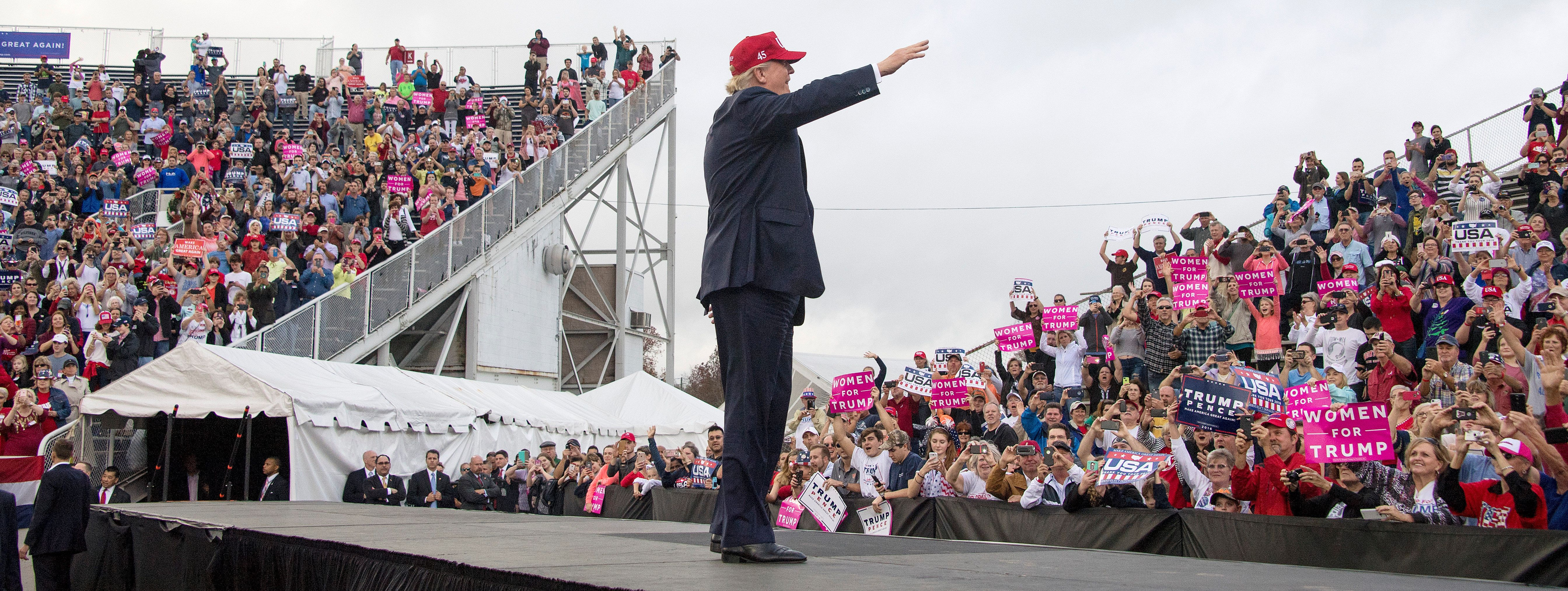 US President-elect Donald Trump waves to supporters in Mobile, Alabama, during a 'Thank You Tour 2016' rally on December 17, 2016.      (JIM WATSON--AFP/Getty Images)