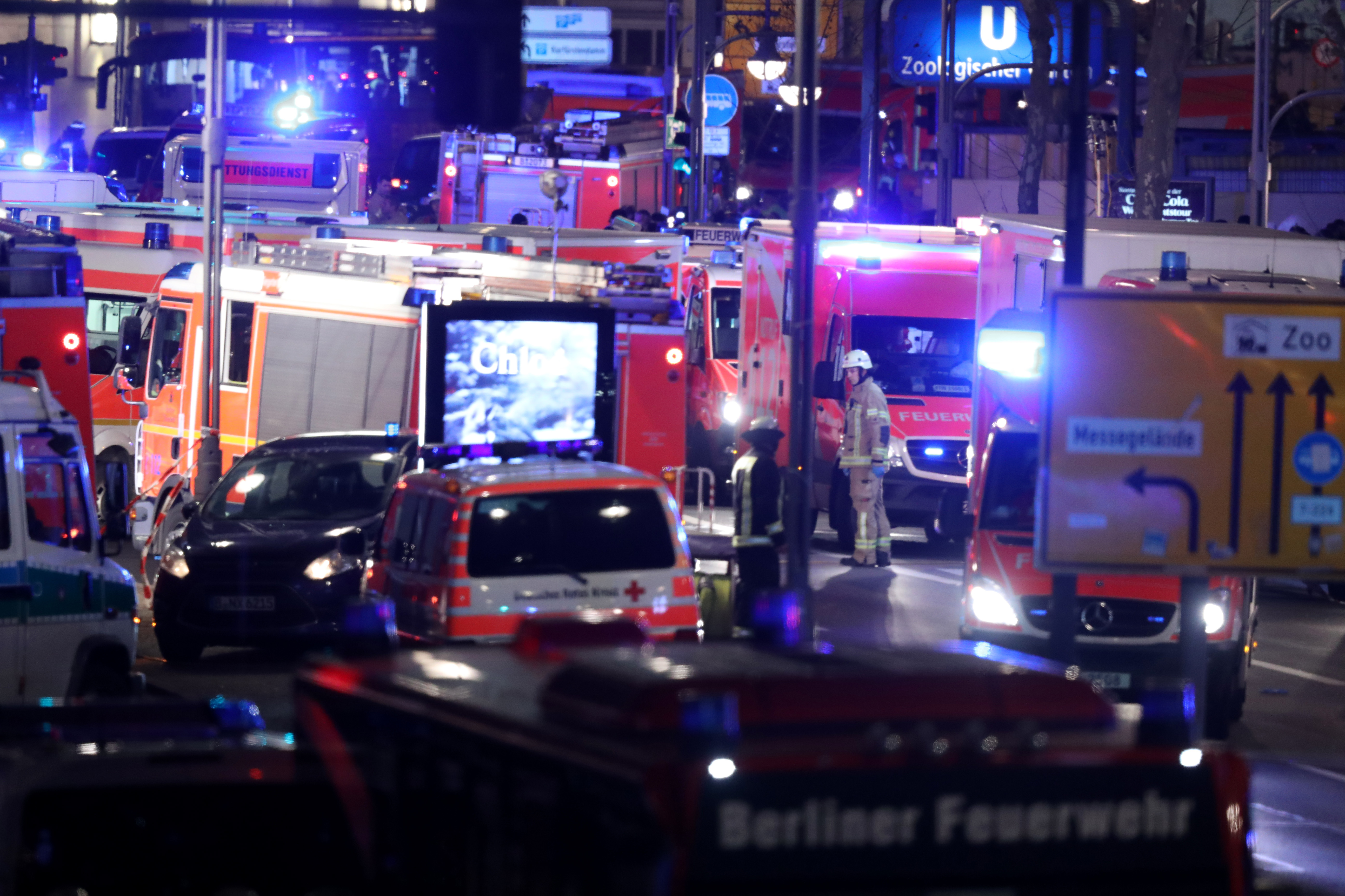 Ambulances line the streets as rescue workers tend to the area after a lorry truck plowed through a Christmas market on December 19, 2016 in Berlin, Germany.