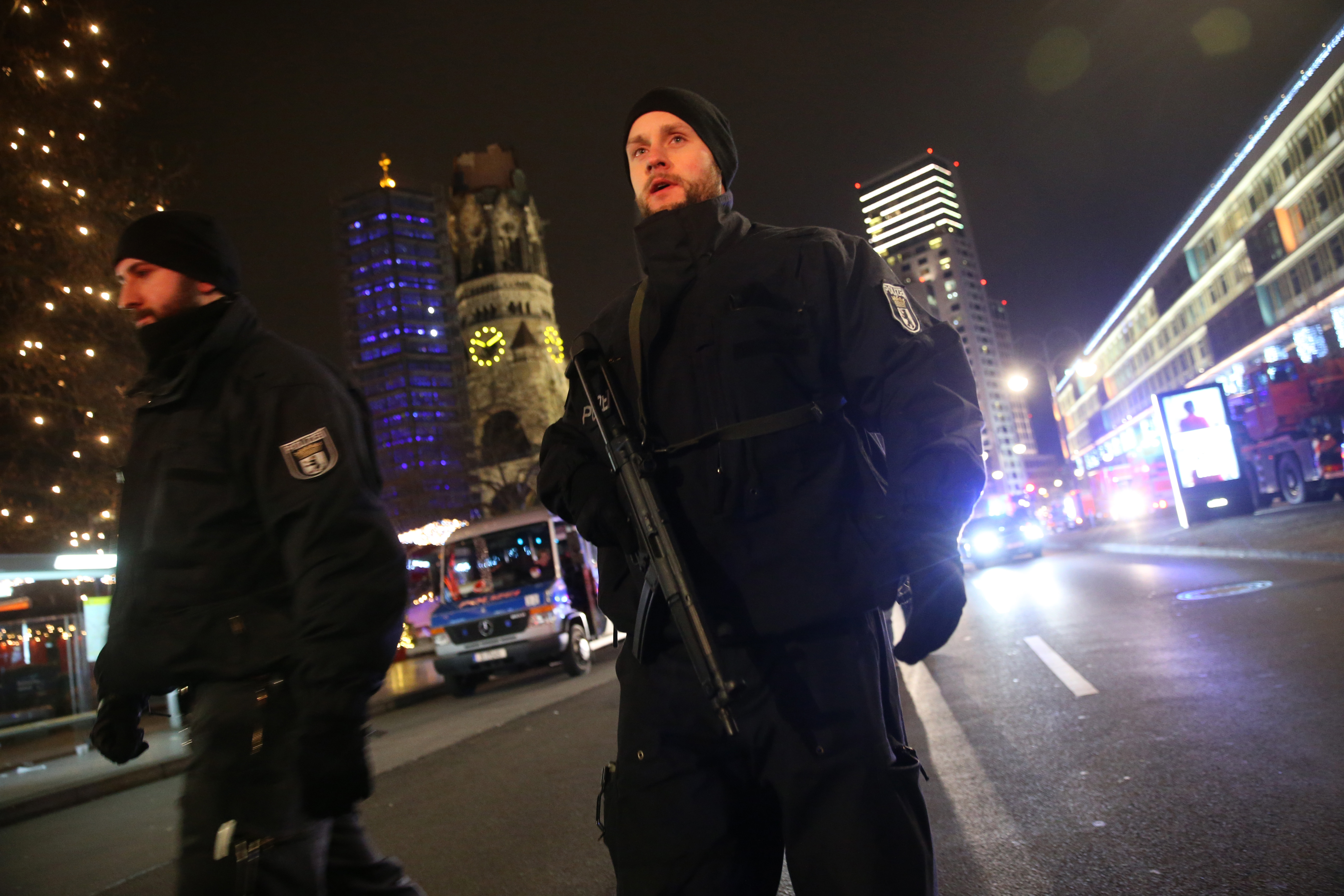 Security stands guard after a lorry plowed through a Christmas market on Dec. 19, 2016 in Berlin