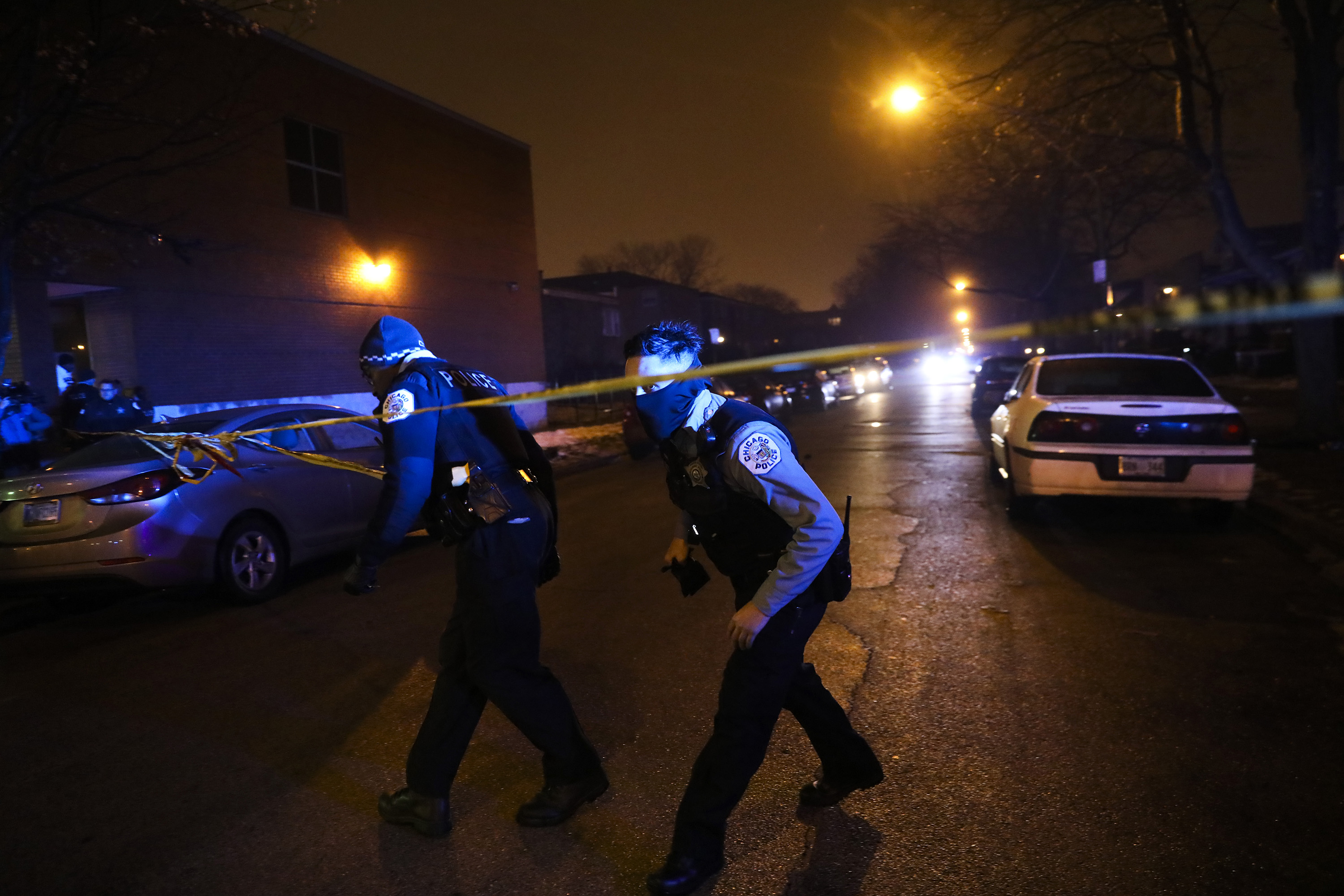 Members of the Chicago Police Department work the scene where at least six people were shot, one fatally, on the 8600 block of South Maryland Avenue on Sunday, Dec. 25, 2016 in Chicago.