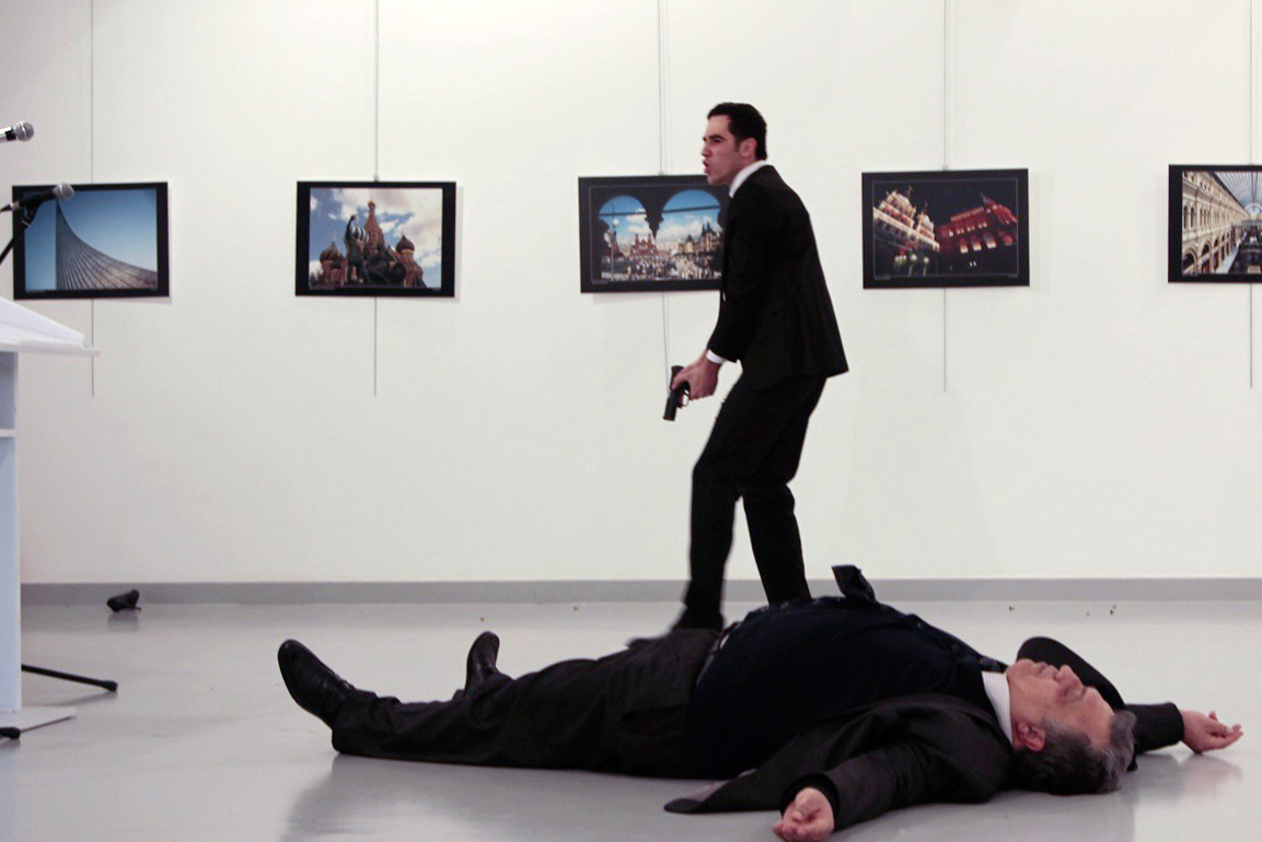 Karlov is seen on the floor after being shot by the gunman at the Ankara gallery on Dec. 19.
