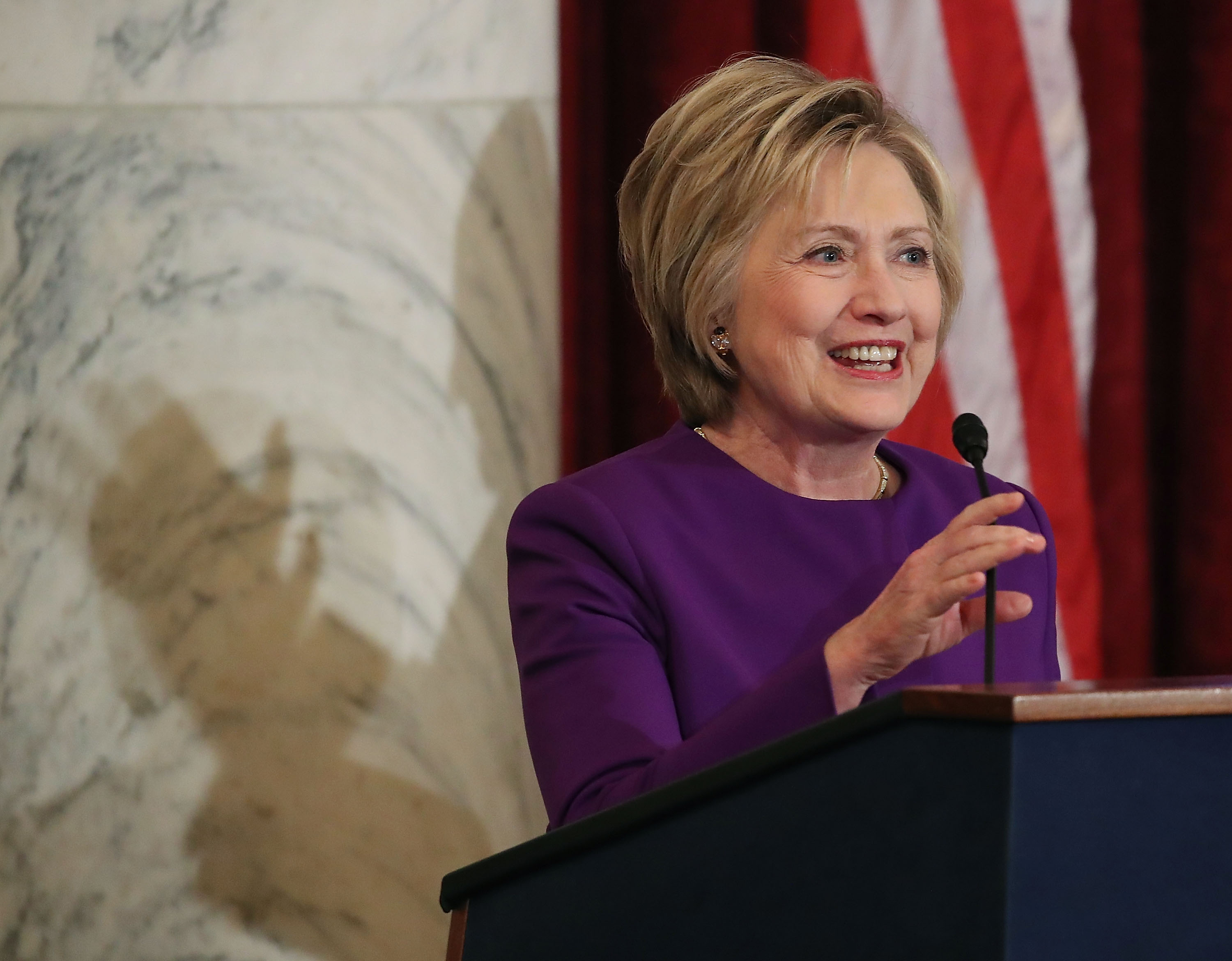 Former US Secretary of State, Hillary Clinton is applauded before speaking at a portrait unveiling ceremony for outgoing Senate Minority Leader Harry Reid (D-NV), on Capitol Hill December 8, 2016 in Washington, DC.