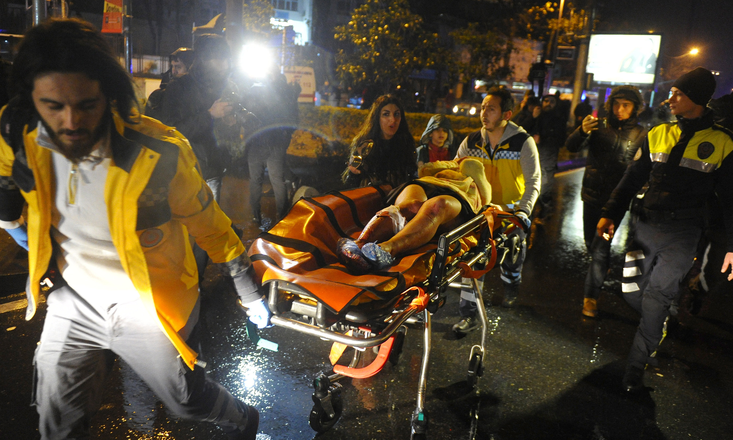 Medical personnel carry an injured woman after an armed attack on a night club in Istanbul on Jan. 1, 2017.