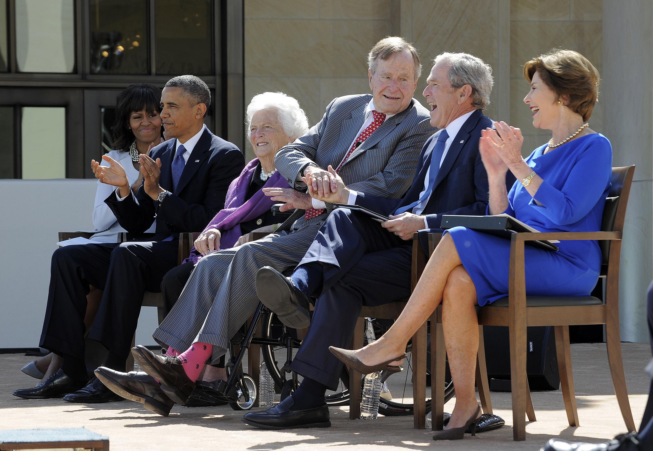 Michelle Obama, Barack Obama former First Lady Barbara Bush, former US President George W. Bush and former US First Lady Laura Bush listen as former President George H.W. Bush speaks during the George W. Bush Presidential Center dedication ceremony in Dallas, Texas, on April 25, 2013.