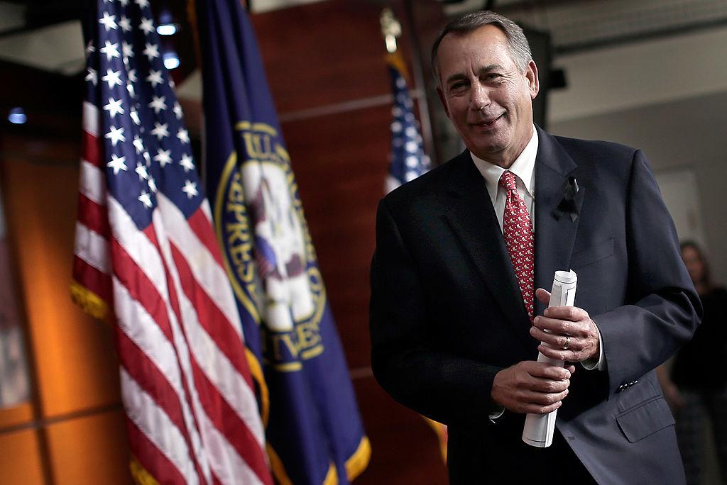 John Boehner departs a press conference Dec. 12, 2013 in Washington, DC.