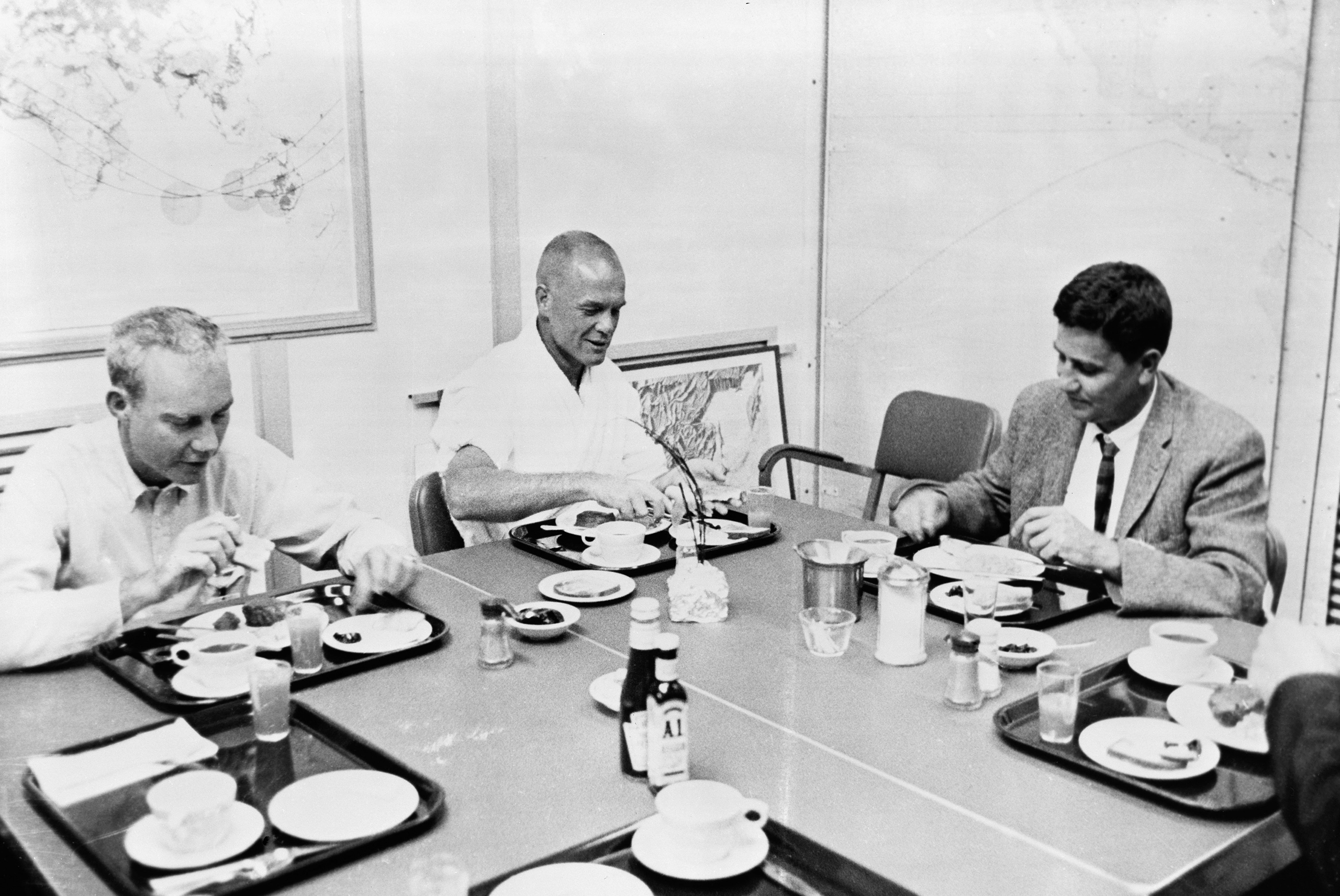 <b>Food for Flight</b>                                   Glenn, center, has his prelaunch breakfast on Feb. 20, 1962, with two NASA officials. The traditional meal — steak, eggs, toast, coffee and juice — was a surprisingly heavy one for a man about to experience the stomach-flipping phenomenon of zero g.