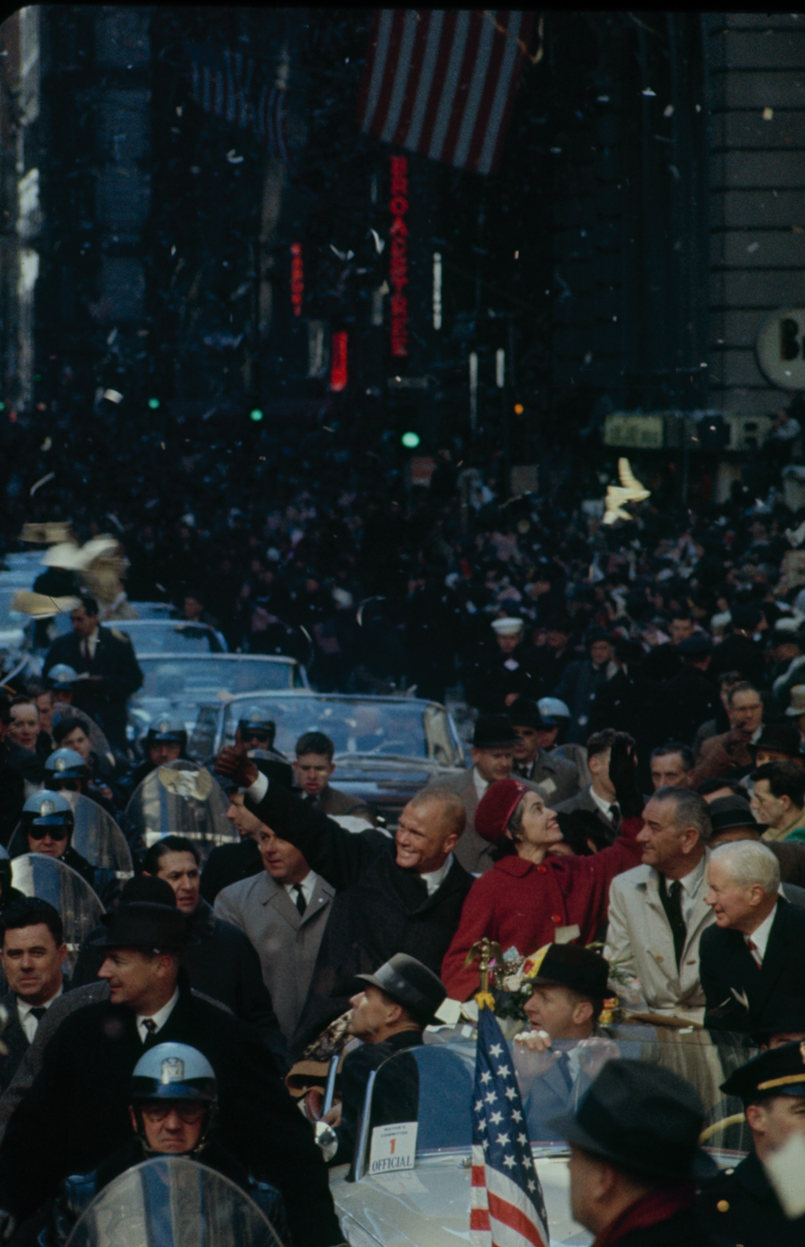 <b>An Adoring Public<b /> Annie Glenn and Vice President Lyndon Johnson ride along as Glenn is accorded the singularly American ritual of a ticker-tape parade in 1962. Johnson led the Kennedy Administration's space push.